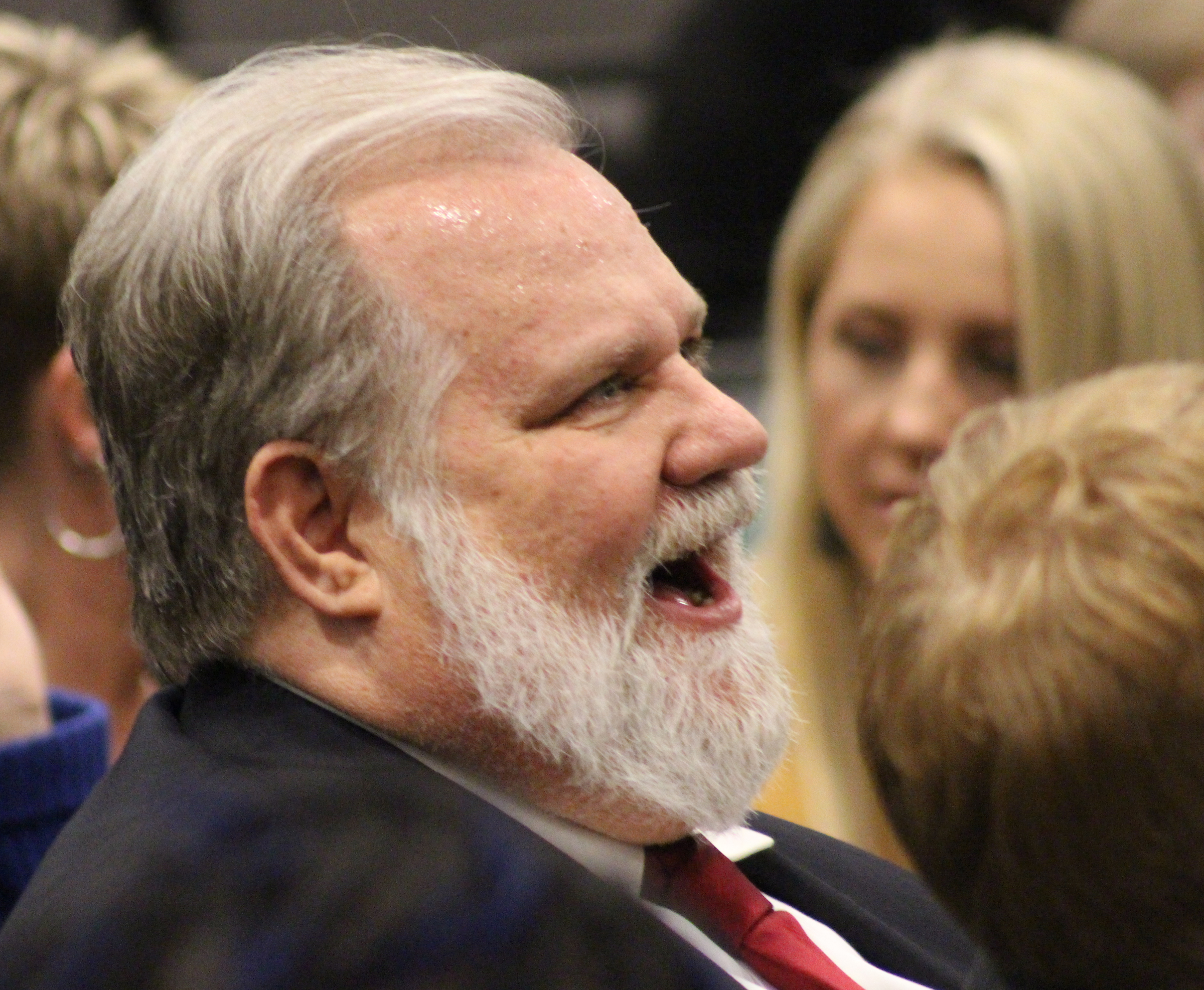 "The husband of Mary ""Peg"" M.Z. Stevens laughs just prior to an investiture ceremony in the Legislative Chambers of the Omaha-Douglas County Civic Center on Friday, Jan. 3, 2020. (Photo by Scott Stewart)"