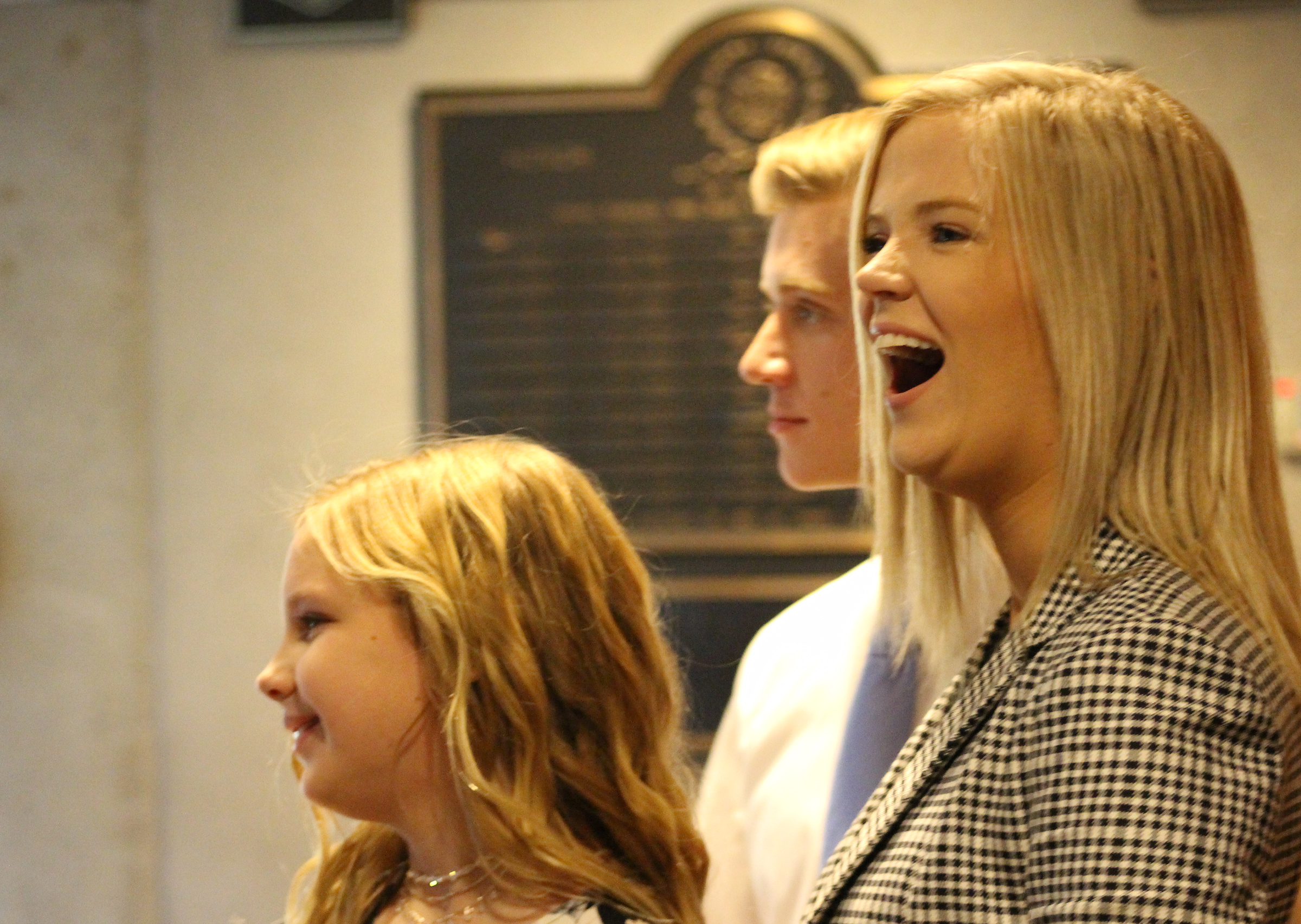 "The children of Mary ""Peg"" M.Z. Stevens laugh just prior to an investiture ceremony in the Legislative Chambers of the Omaha-Douglas County Civic Center on Friday, Jan. 3, 2020. (Photo by Scott Stewart)"