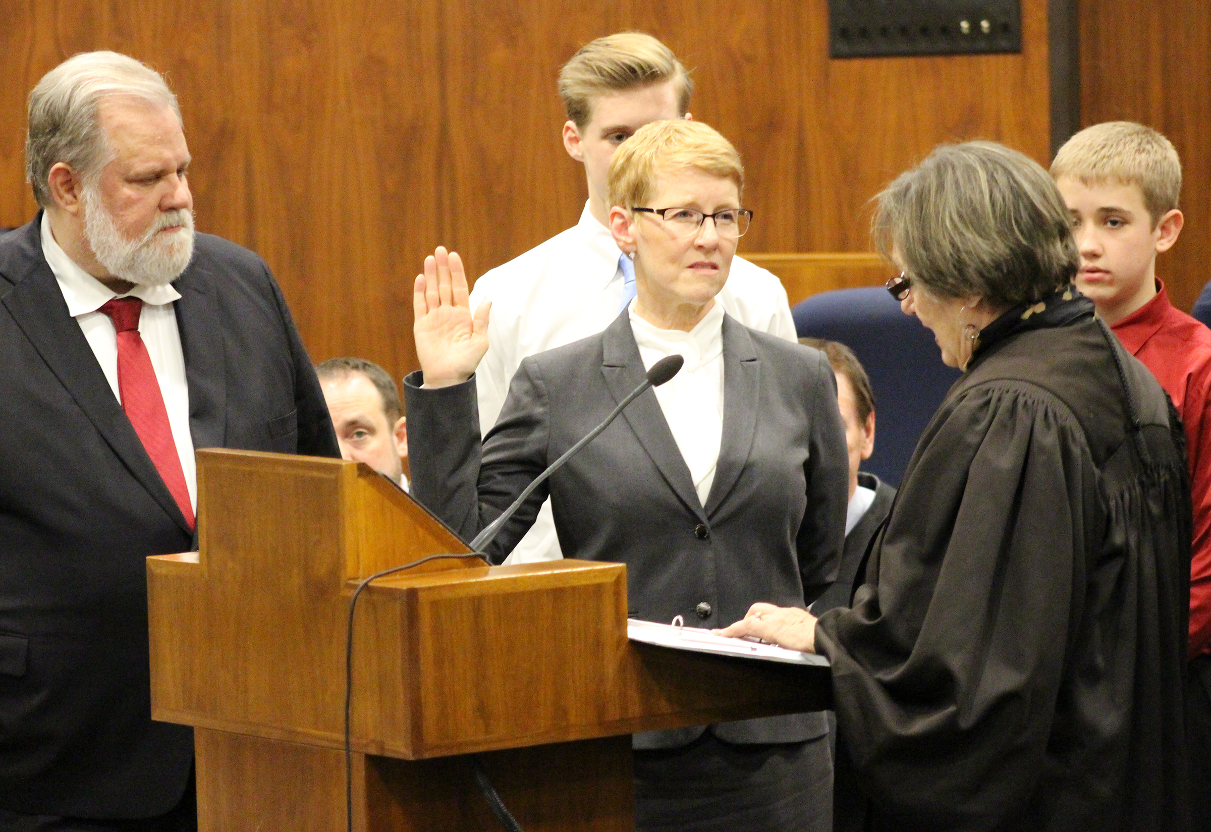 "Douglas County Juvenile Court Judge Mary ""Peg"" M.Z. Stevens takes the oath of office from retired judge Patricia A. Lamberty during an investiture ceremony in the Legislative Chambers of the Oma-ha-Douglas County Civic Center on Friday, Jan. 3, 2020. (Photo by Scott Stewart)"