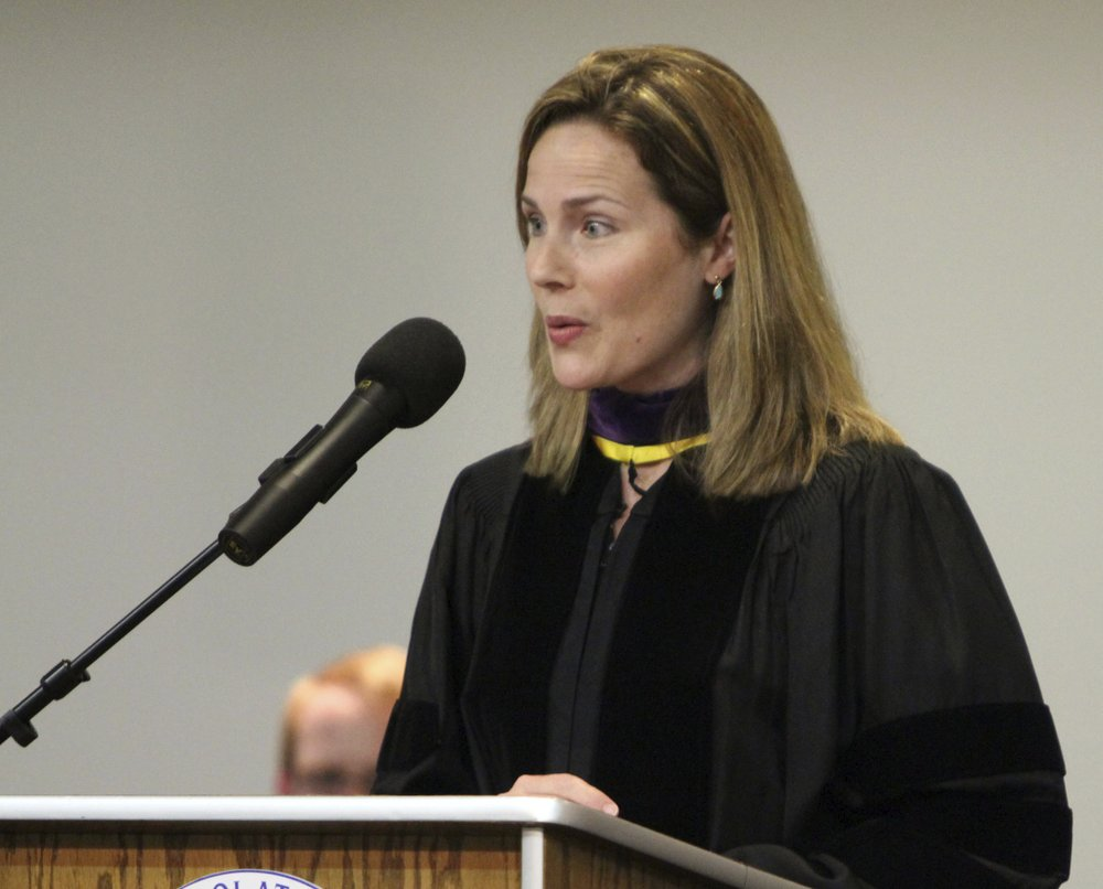 Then-University of Notre Dame law professor Amy Coney Barrett gives the commencement address June 11, 2011, to Trinity at Greenlawn graduates at the Trinity People of Praise Center in South Bend, Ind. (Barbara Allison/South Bend Tribune via AP)