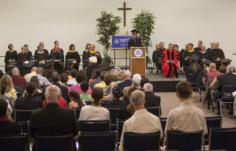 Nathaniel Griggs delivers the valedictory address June 8, 2013, during the Trinity School commencement ceremony inside the People of Praise Community Center in South Bend, Ind.         (Robert Franklin/South Bend Tribune via AP)