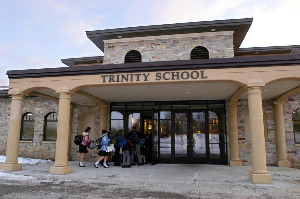 Students head into class at Trinity School at River Ridge's new campus in Eagan, Minn., Jan. 14, 2008. (Dawn Villella/Pioneer Press via AP)