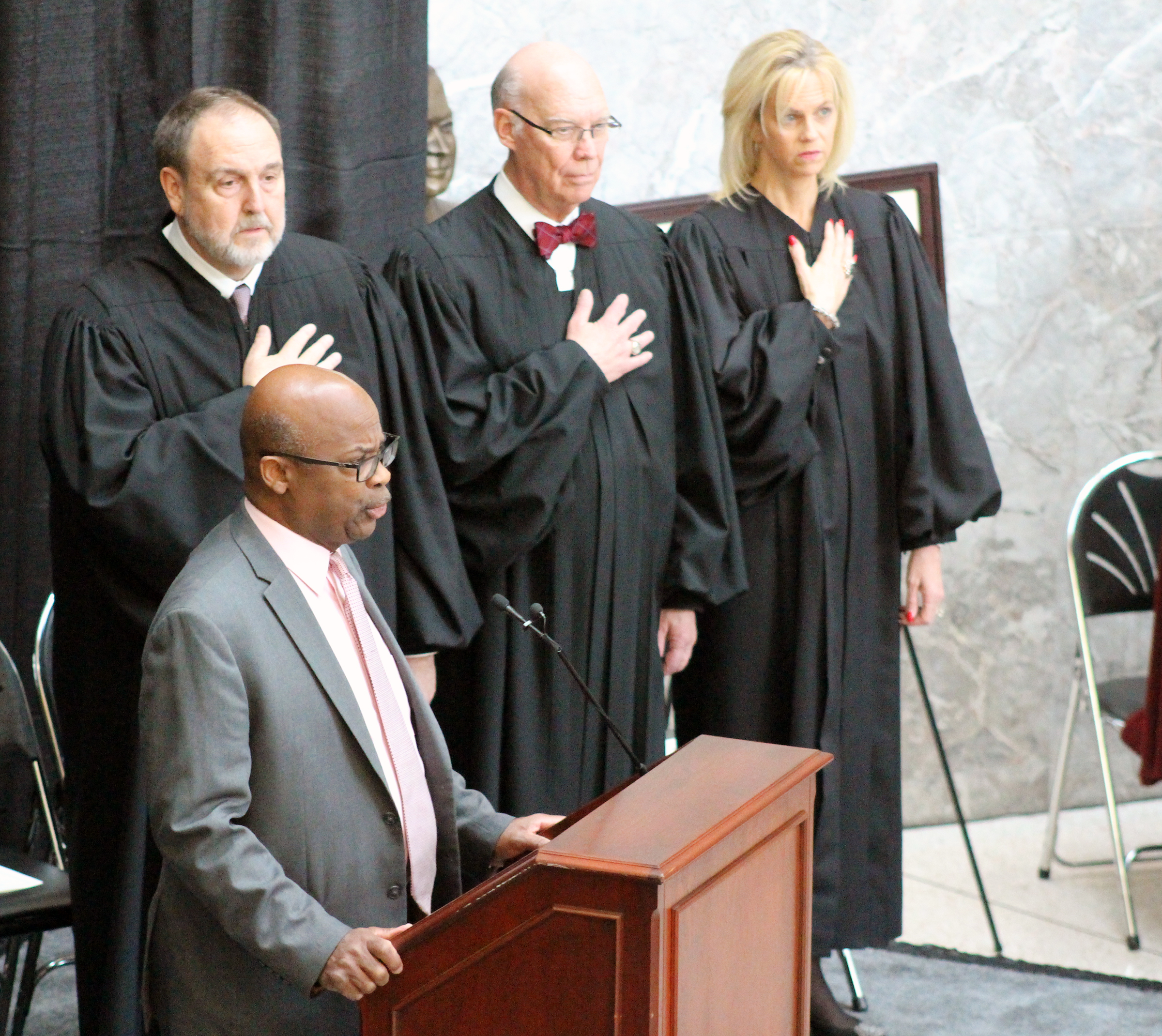 """Franklin Thompson led the singing of """"The Star-Spangled Banner"""" at Brian C. Buescher's investiture ceremony at the Hruska Federal Courthouse on Friday, Nov. 15, 2019. (Photo by Scott Stewart)"""