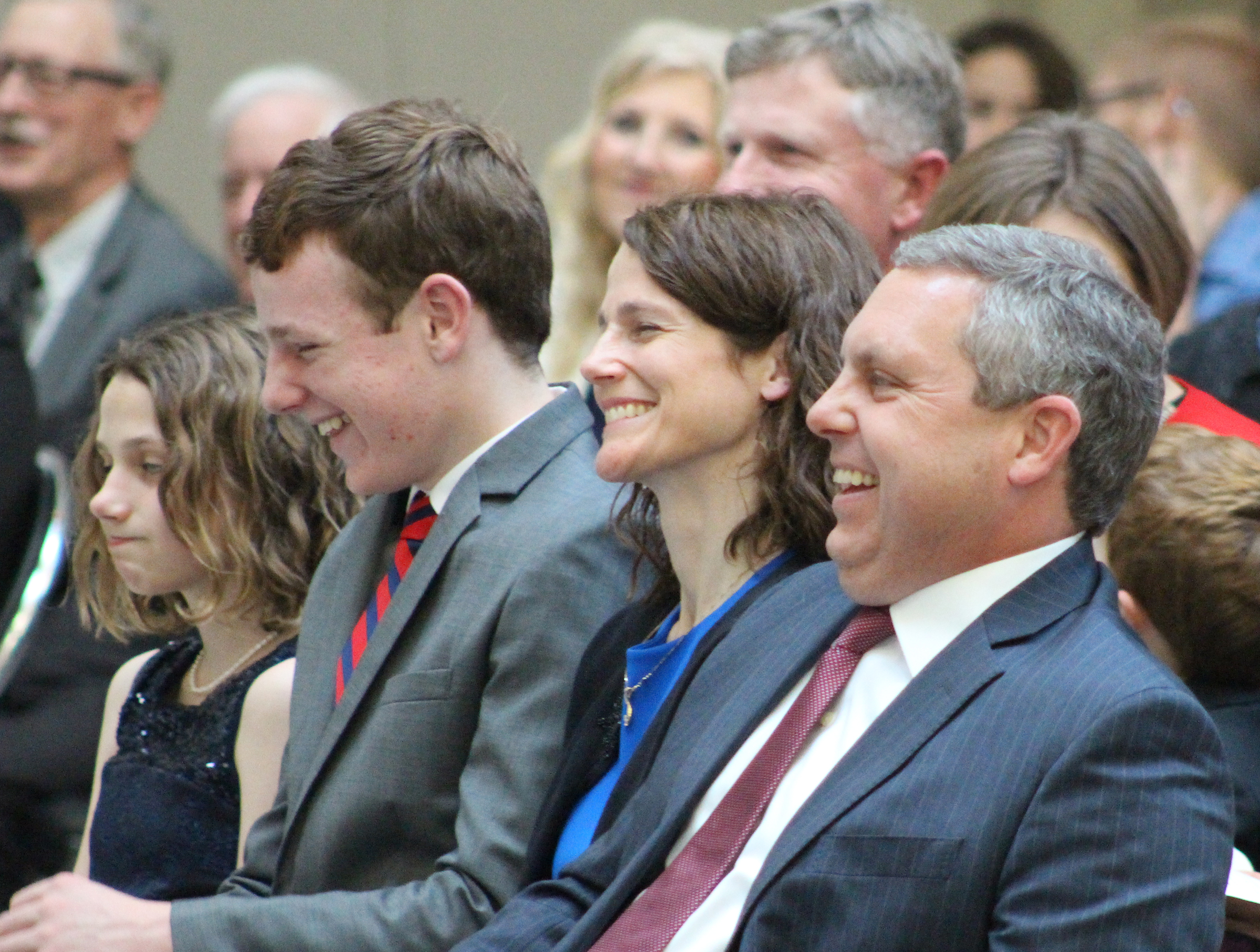 Brian C. Buescher laughs during U.S. Sen. Ben Sasse's remarks during his investiture ceremony at the Hruska Federal Courthouse on Friday, Nov. 15, 2019. (Photo by Scott Stewart)