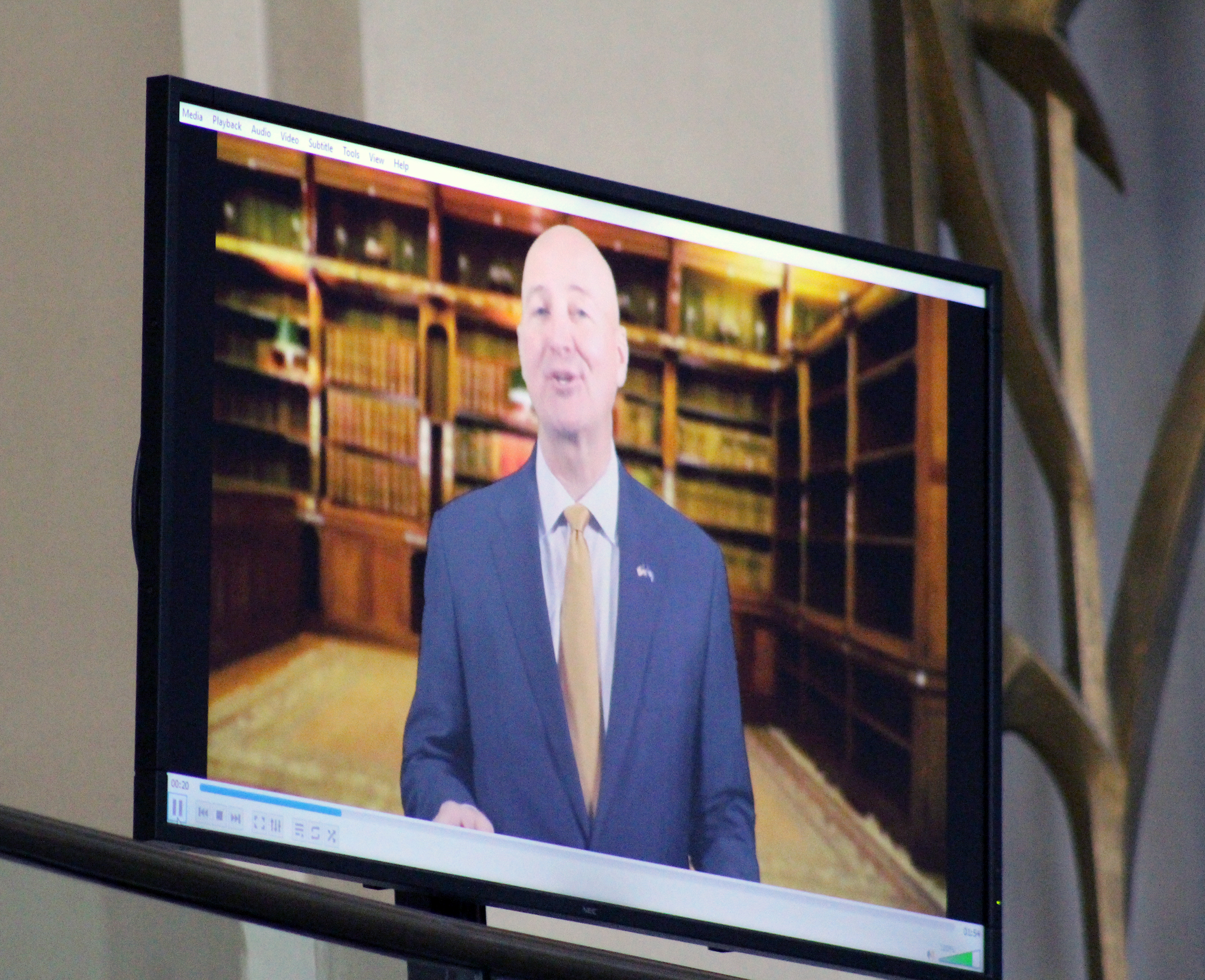 Nebraska Gov. Pete Ricketts delivers remarks by video during Brian C. Buescher's investiture ceremony at the Hruska Federal Courthouse on Friday, Nov. 15, 2019. (Photo by Scott Stewart)