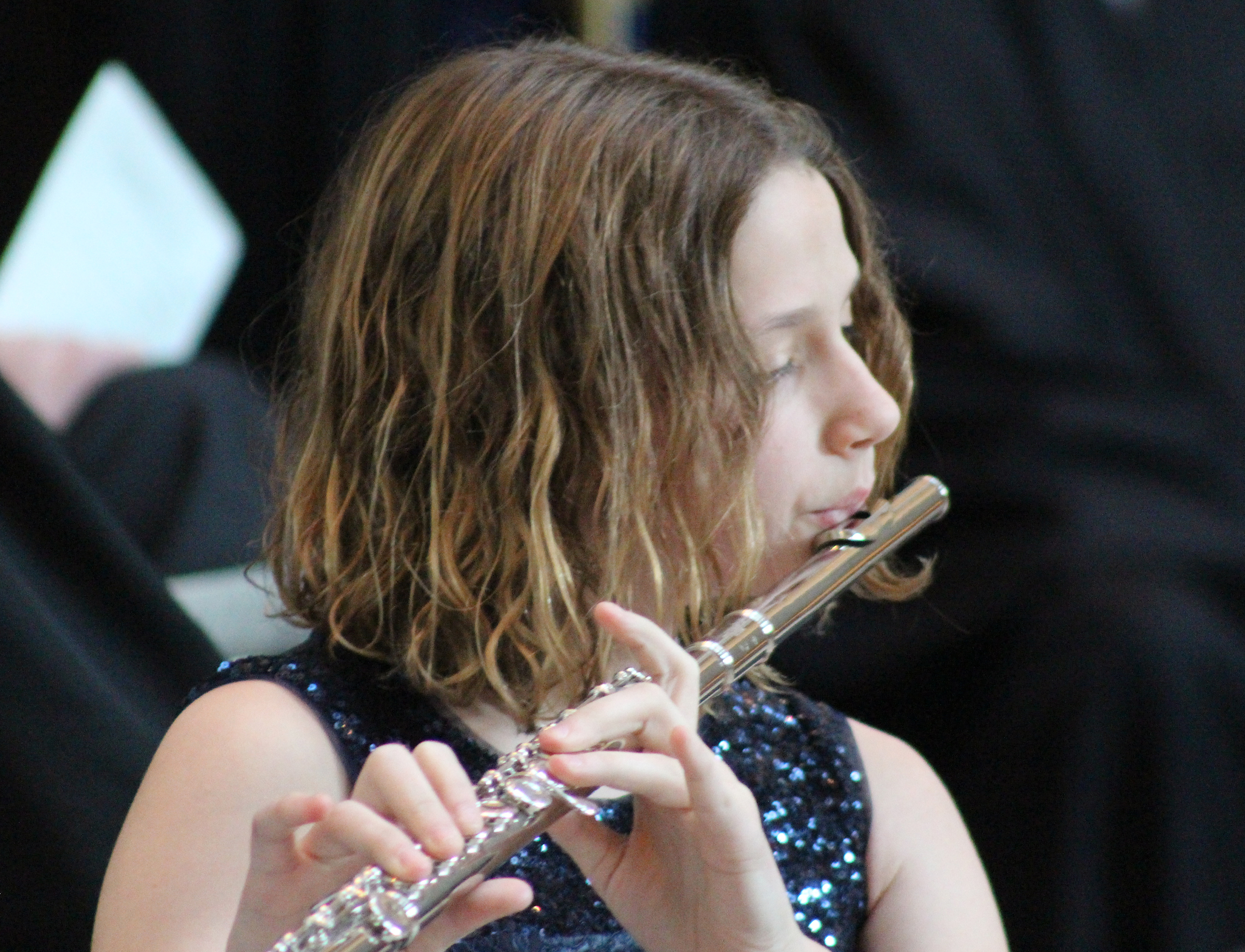 Elizabeth Buescher plays the flute at her father's investiture ceremony at the Hruska Federal Courthouse on Friday, Nov. 15, 2019. (Photo by Scott Stewart)