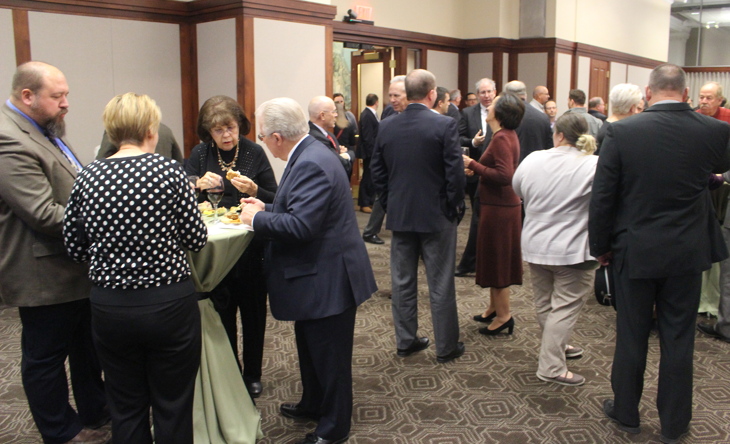 A reception was held at Kutak Rock's office in the Omaha Building following Brian C. Buescher's investiture ceremony at the Hruska Federal Courthouse on Friday, Nov. 15, 2019. (Photo by Scott Stewart)
