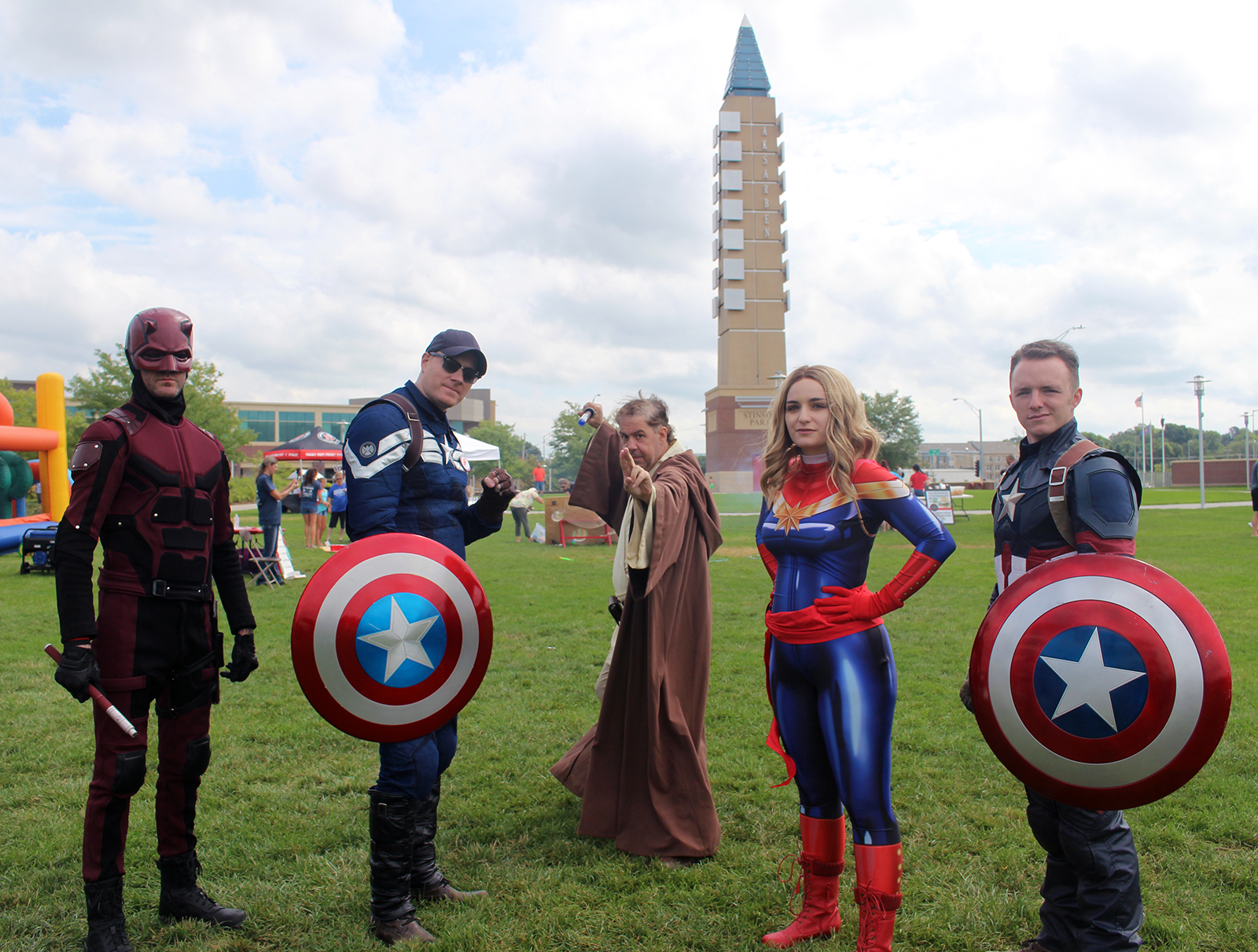 Superheroes from Midwest TeamHooman take a break from handing out free comic books to take a group photo at Stinson Park during CASA for Douglas County's Superhero Festival on Saturday, Aug. 26, 2019. (Photo by Scott Stewart)