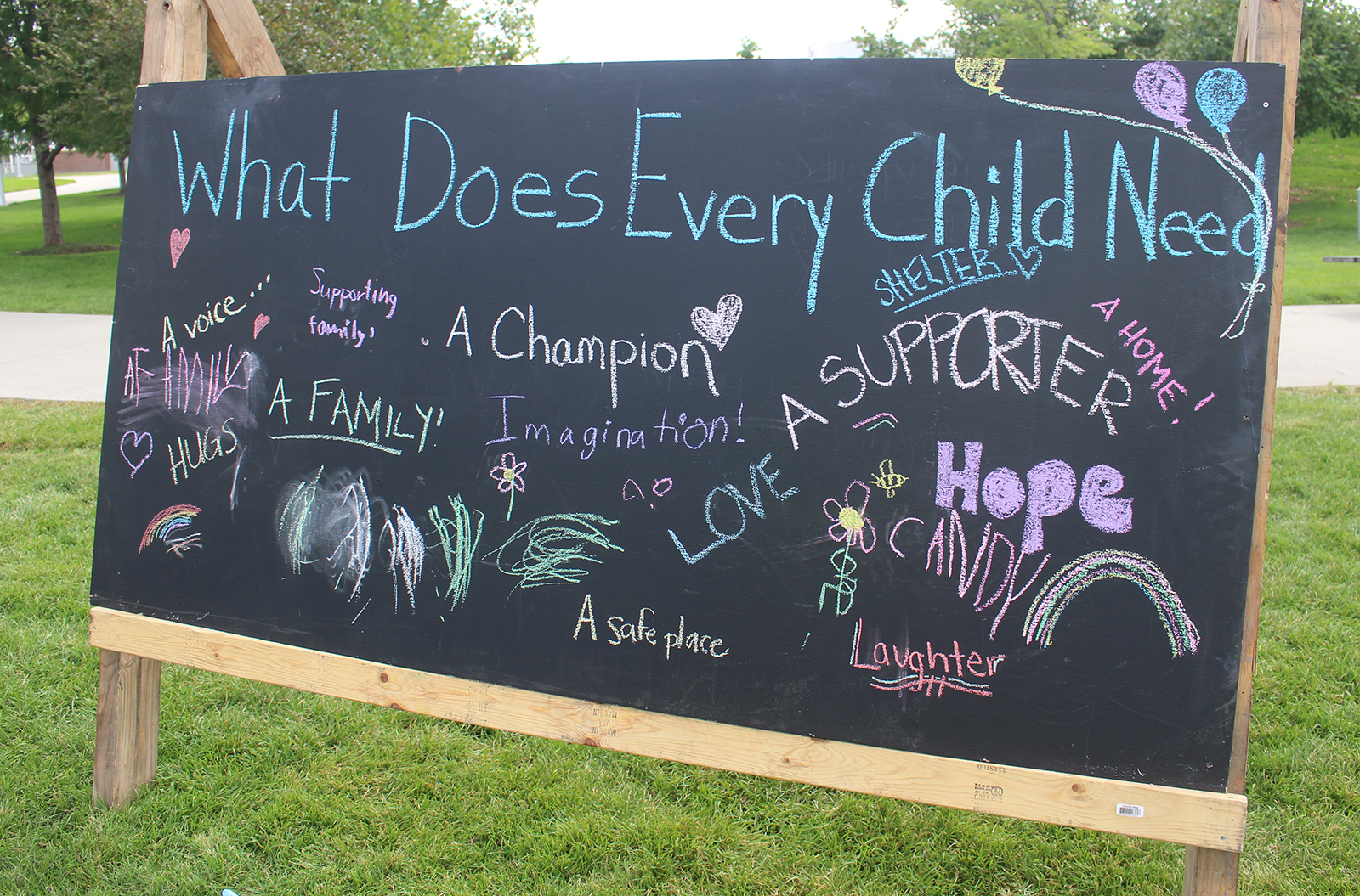 A sign at CASA for Douglas County's Superhero Festival invites guests to share their views on what children need. (Photo by Scott Stewart)