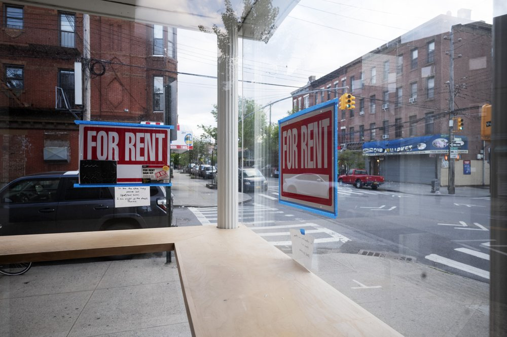 """A storefront displays """"For Rent"""" signs in the window in the Red Hook neighborhood of the Brooklyn borough of New York on May 12, 2020. Some small businesses are closing for good due to the economic crisis brought on by the coronavirus pandemic. (AP)"""