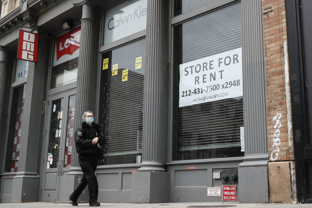 A pedestrian passes a storefront available for rent on Broadway south of Canal Street in the Manhattan borough of New York on April 27, 2020. Many businesses devastated by the pandemic are expected to abandon offices and storefronts. The changes are happening because more employees are working from home, and more people are shopping online. (AP)