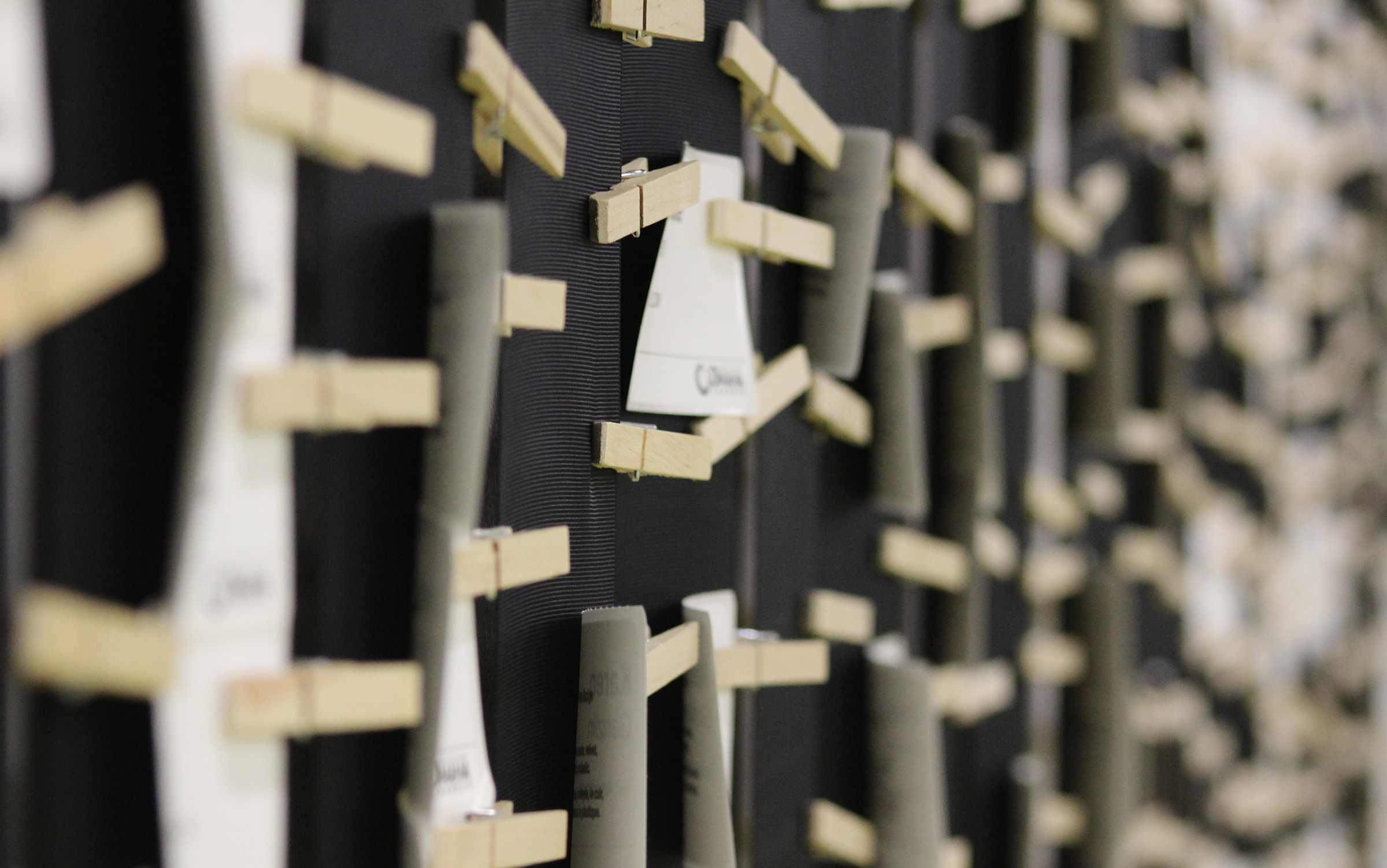 Columns of name tags were affixed to a wall using cloth pins at the Greater Omaha Chamber offices on Thursday, Dec. 5, 2019. (Photo by Scott Stewart)