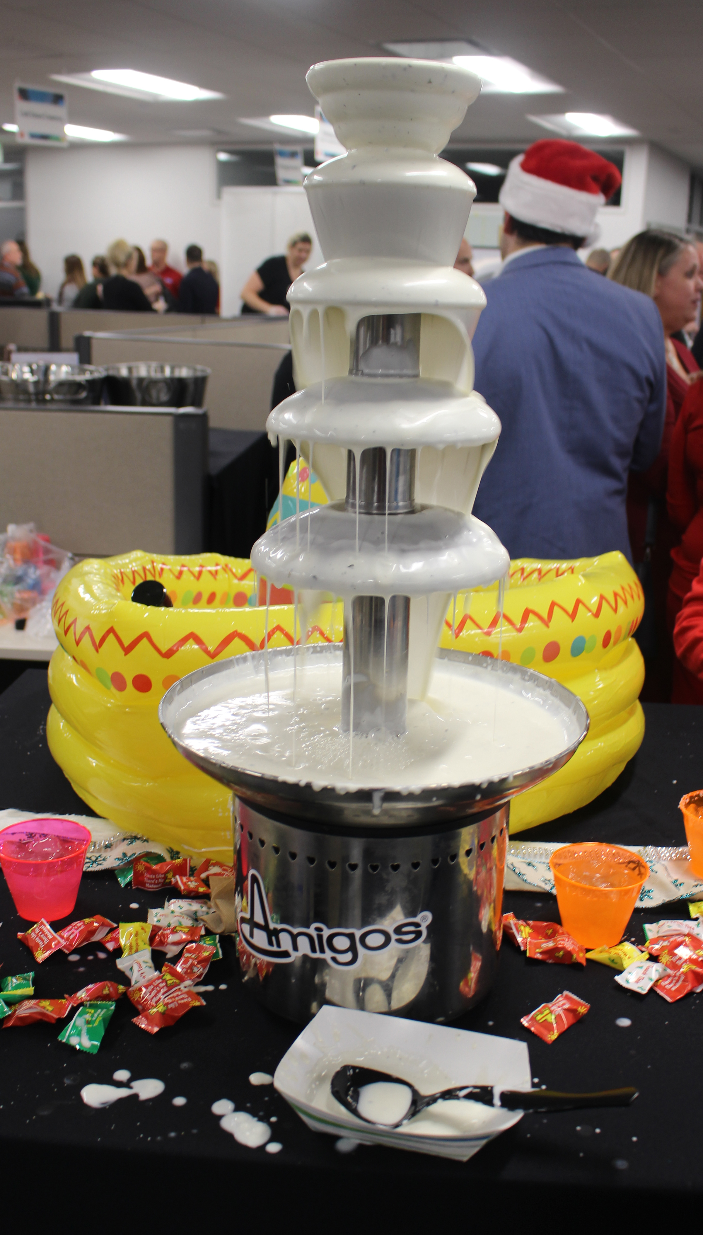 Amigos, one of the many vendors at the Member Appreciation Holiday Open House at the Greater Omaha Chamber build-ing, featured a queso fountain. (Photo by Scott Stewart)