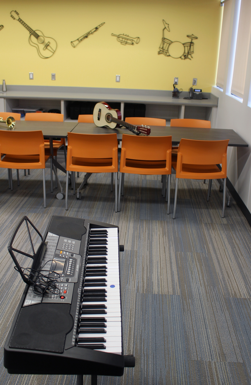 A music room in the recently renovated and expanded Completely KIDS headquarters, 2566 St. Mary's Ave., provides a permanent home for a program that started at the suggestion of a Brownell Talbot high schooler. The class had previously met in the nonprofit's stairwell. (Photo by Scott Stewart)