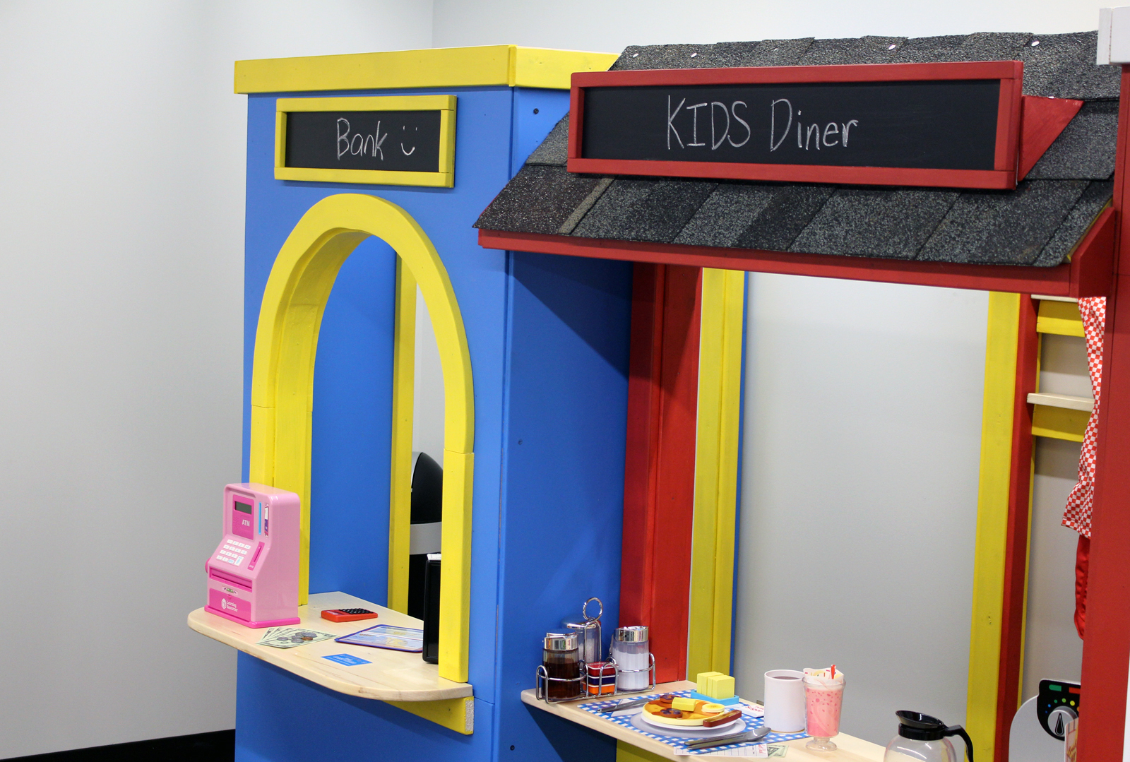Classroom spaces at the Completely KIDS headquarters, 2566 St. Mary's Ave., include movable pieces that help young children explore careers and have structured playtime together. (Photo by Scott Stewart)