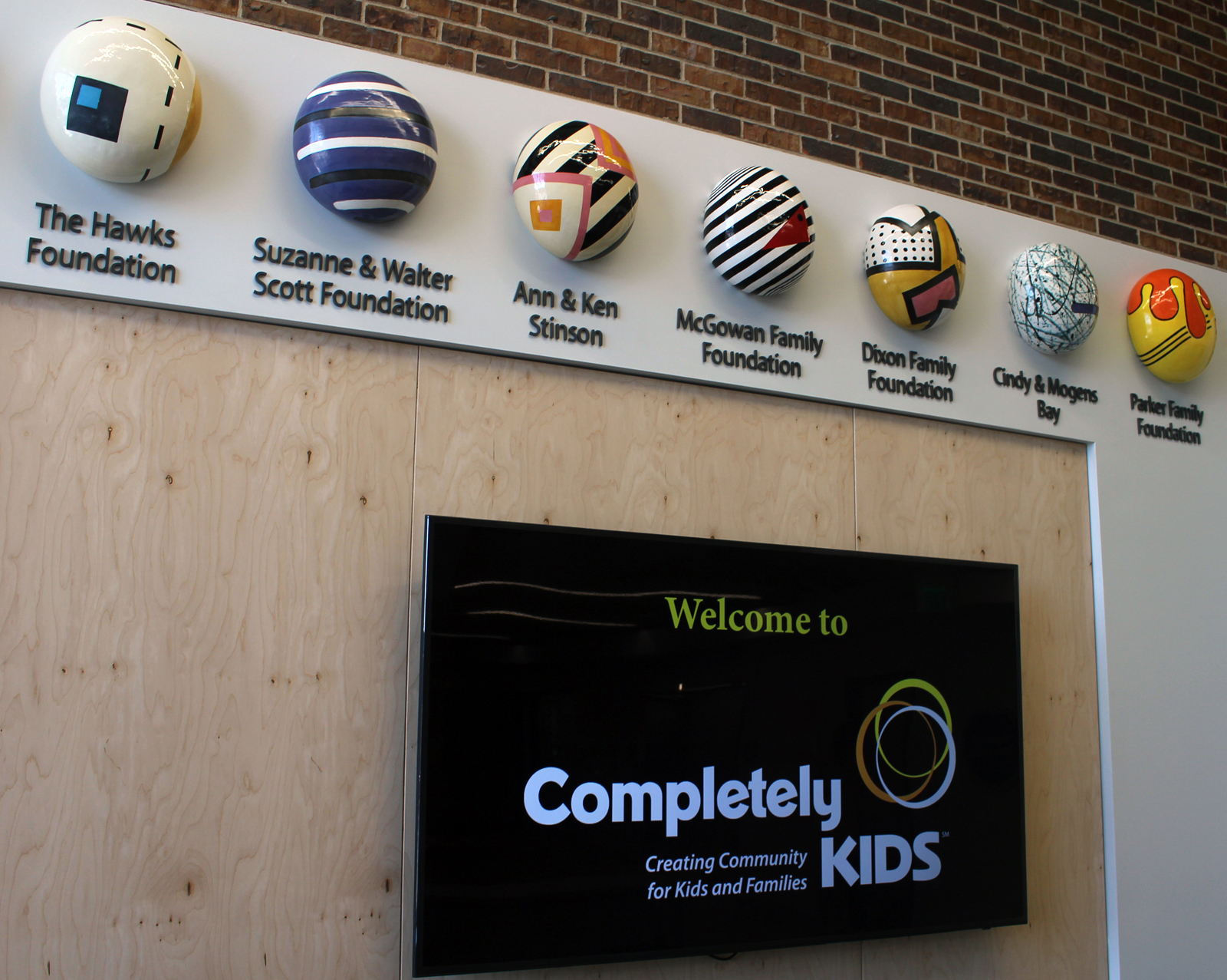 """Major donors to the $10 million Completely KIDS capital campaign for its new headquarters space are recognized with artistic """"jellybeans"""" in the main entrance to the facility at 2566 St. Mary's Ave. (Photo by Scott Stewart)"""