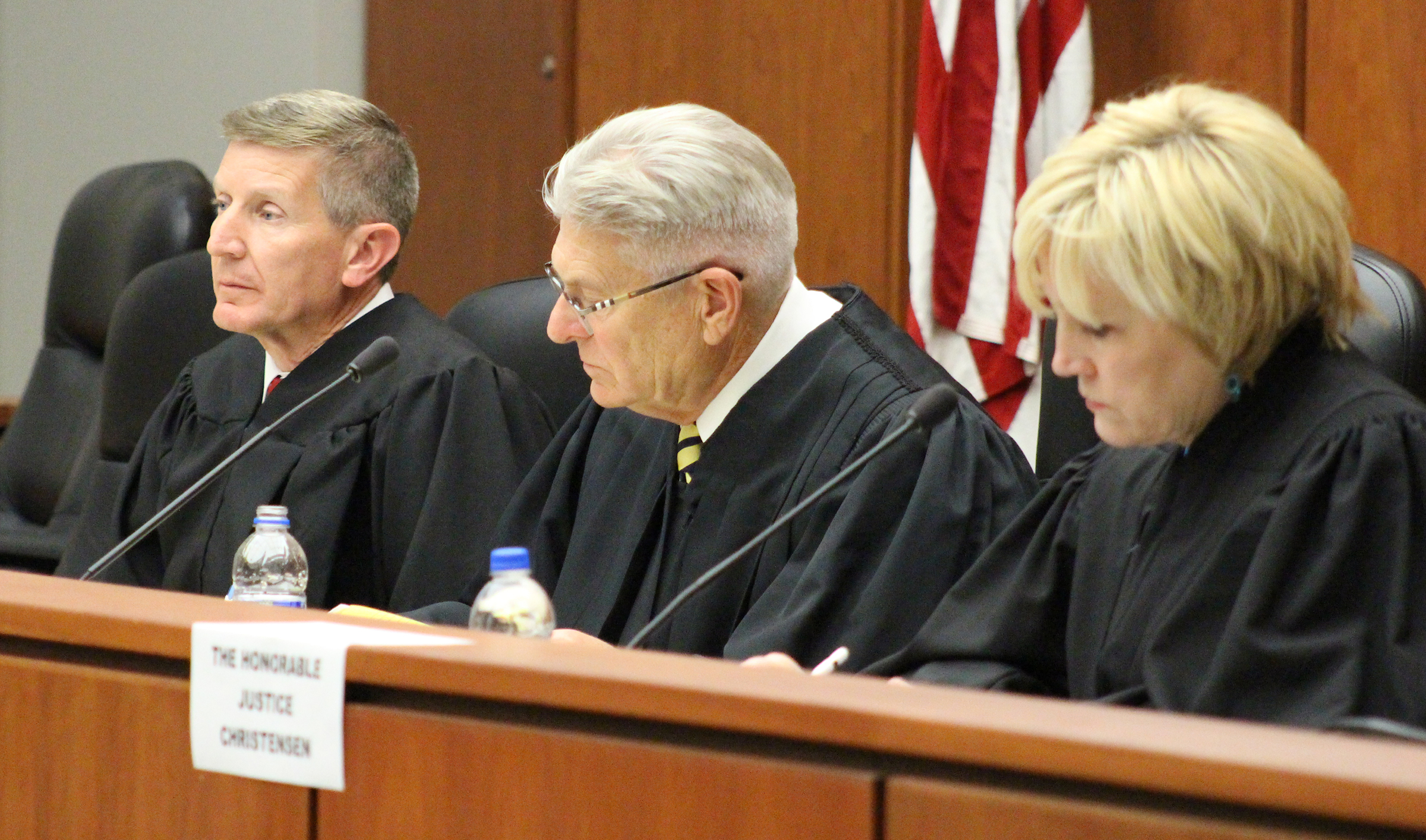 From left, U.S. Eighth Circuit Court of Appeals Judge Steven Grasz, Nebraska Supreme Court Chief Justice Michael Heavican and Iowa Supreme Court Justice Susan Christensen sit to hear the final round of the moot court competition. (Photo by Scott Stewart)