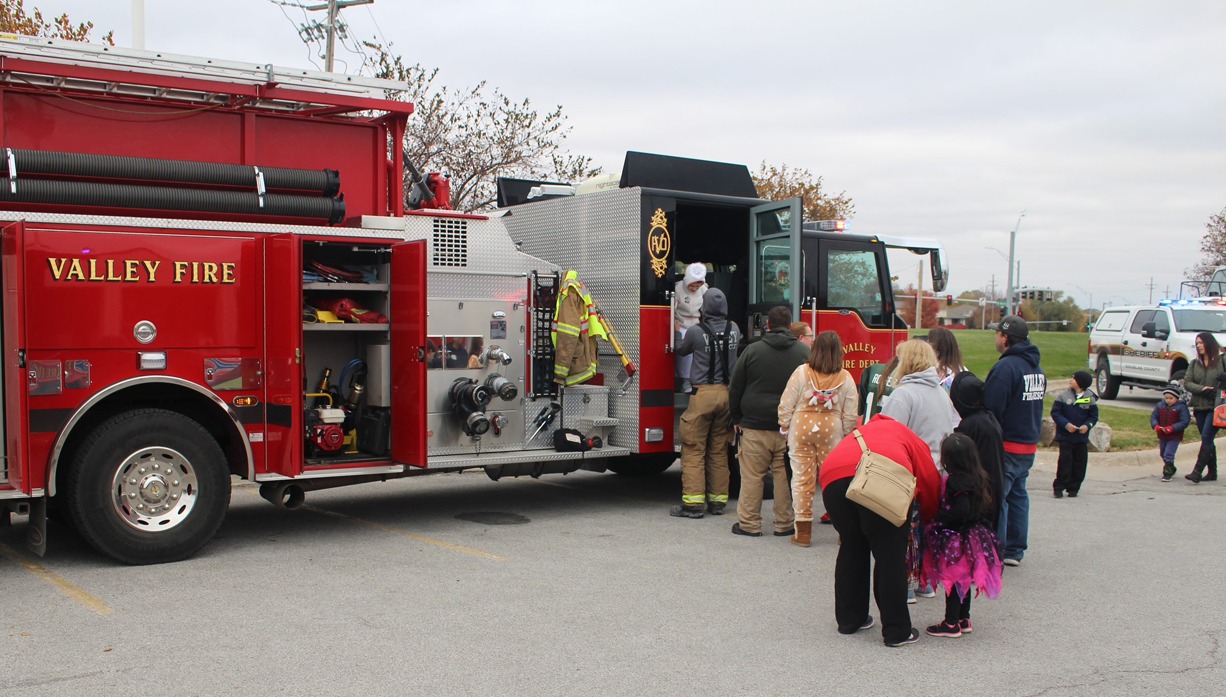 Families line up to trick-or-treat at a Valley Fire Department engine on Saturday, Oct. 27, 2019. (Photo by Scott Stewart)