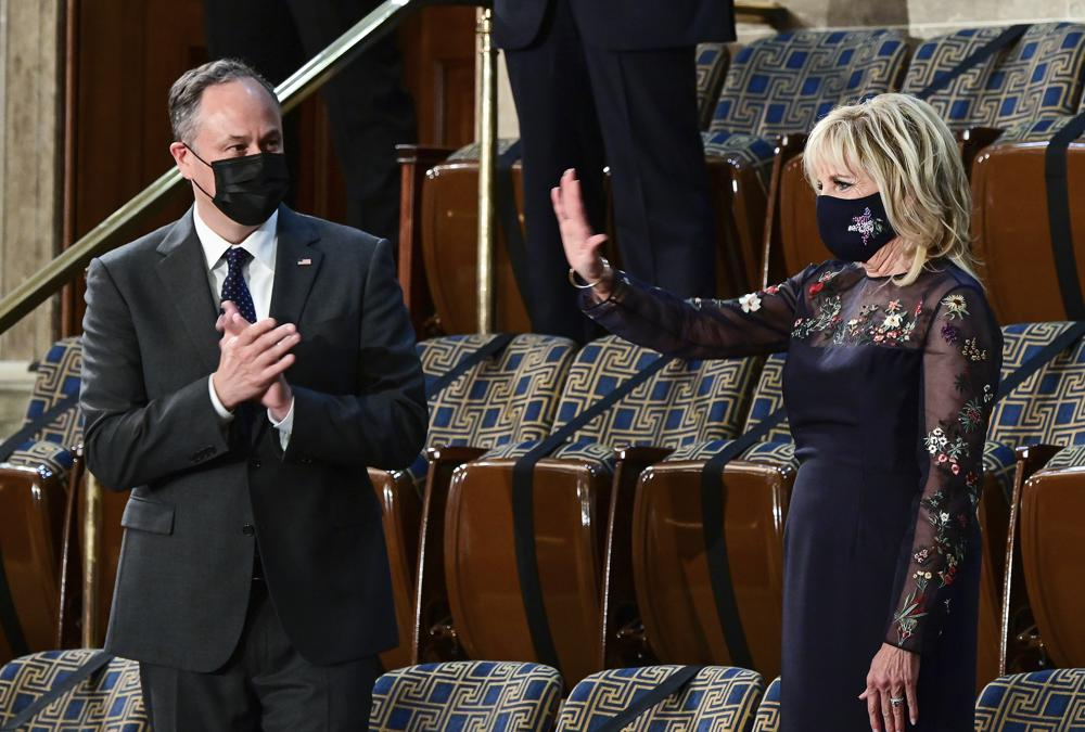 Doug Emhoff, husband of Vice President Kamala Harris, applauds as first lady Jill Biden waves as President Joe Biden addresses a joint session of Congress, Wednesday, April 28, 2021, in the House Chamber at the U.S. Capitol in Washington. (Melina Mara/Pool via AP)