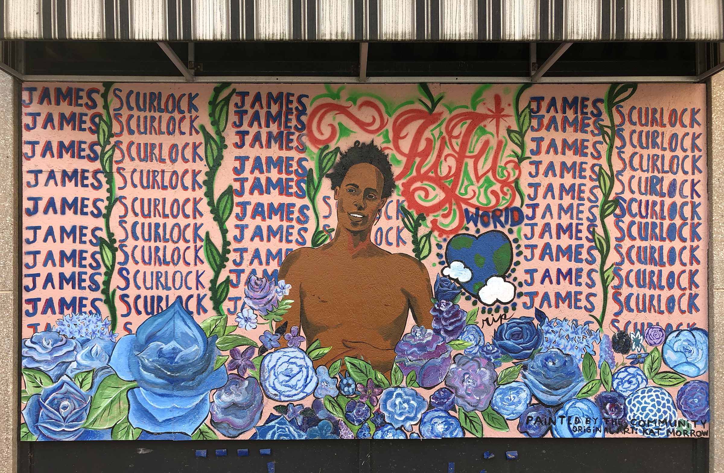 A mural painted on a boarded-up window of Culprit Cafe at 16th and Farnam streets in Omaha shows an illustration by Kat Morrow depicting James Scurlock surrounded by flowers and his name, Wednesday, Sept. 16, 2020. (Scott Stewart/Daily Record)
