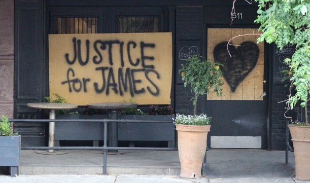 """Boarded up windows at La Buvette Omaha in the Old Market calls for """"Justice for James"""" and support for the Black Lives Matter movement on Tuesday, June 2, 2020. (Scott Stewart/Daily Record)"""