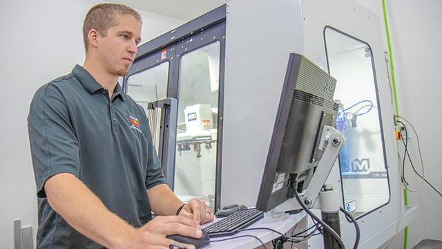Jim Higgins, chief engineer and Nebraska alumnus, works on a drone system prototype. The company has also hired University of Nebraska-Lincoln undergraduate students to work as interns. (Courtesy Alyssa Amen/NUtech Ventures/UNL)