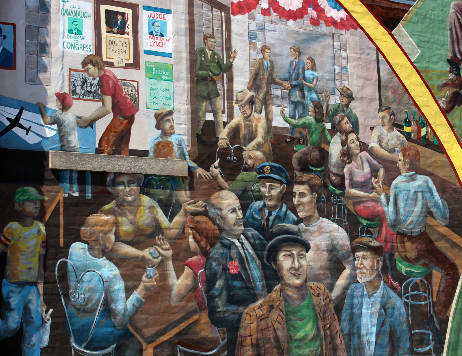 A new mural at Donohue's Irish Pub at 33rd and L streets shows the story of the progress of the Irish community in Nebraska. It is the latest public artwork by the South Omaha Mural Project. (Photo by Scott Stewart)