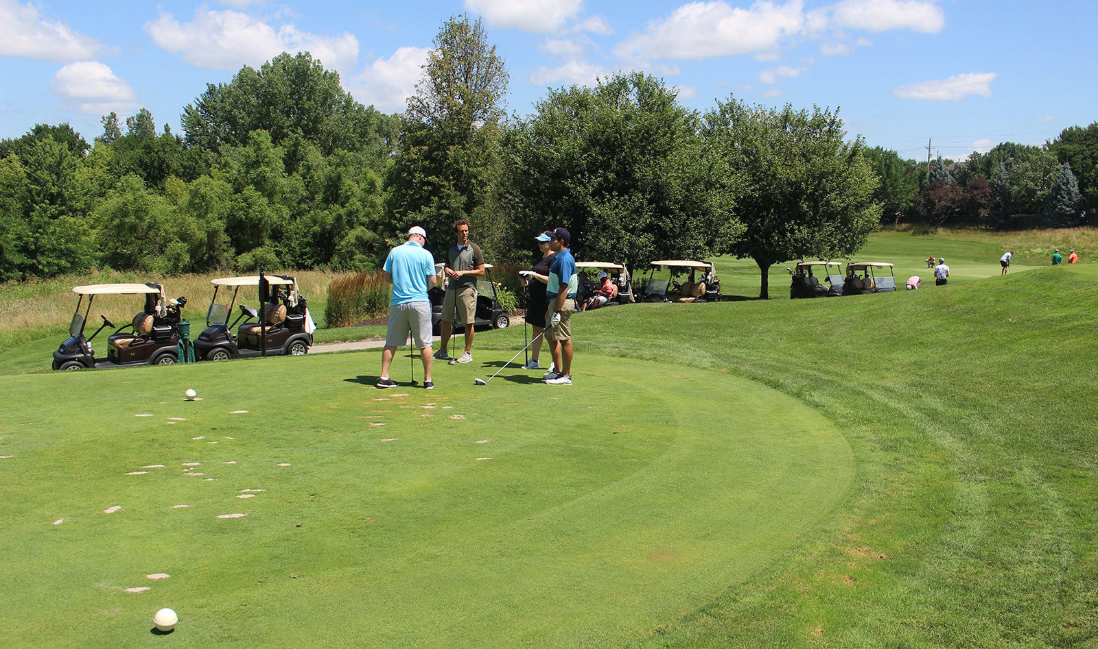 Monday was a perfect day to hit the links for the Omaha Bar Association Field Day, held at Champions Run. Foursomes spent the afternoon golfing, socializing, talking shop and enjoying beverages while temperatures were just shy of 80 degrees. (Photo by Scott Stewart)