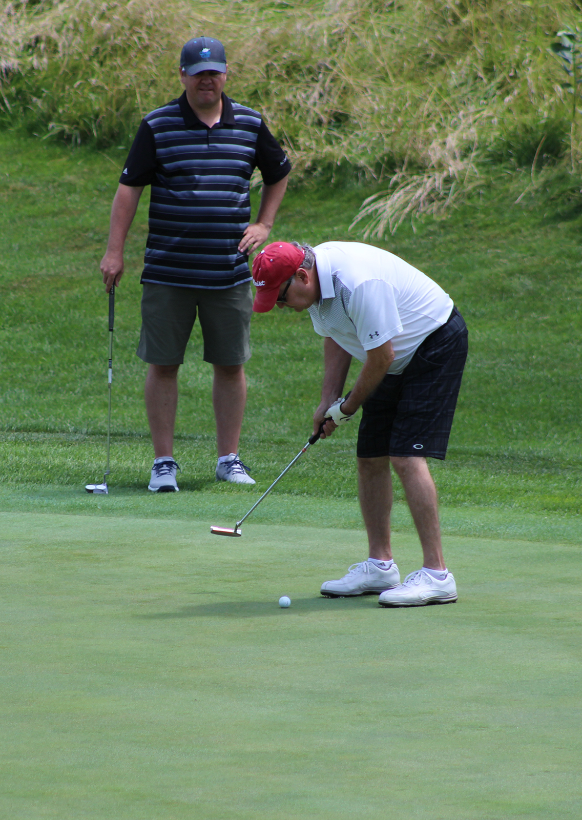 Champions Run Golf Course hosted the OBA Field Day last Monday, with players starting at noon with a shotgun start and a scramble format. Prizes were offered at each hole, with mulligans and long-drive assistance for sale. (Photo by Scott Stewart)