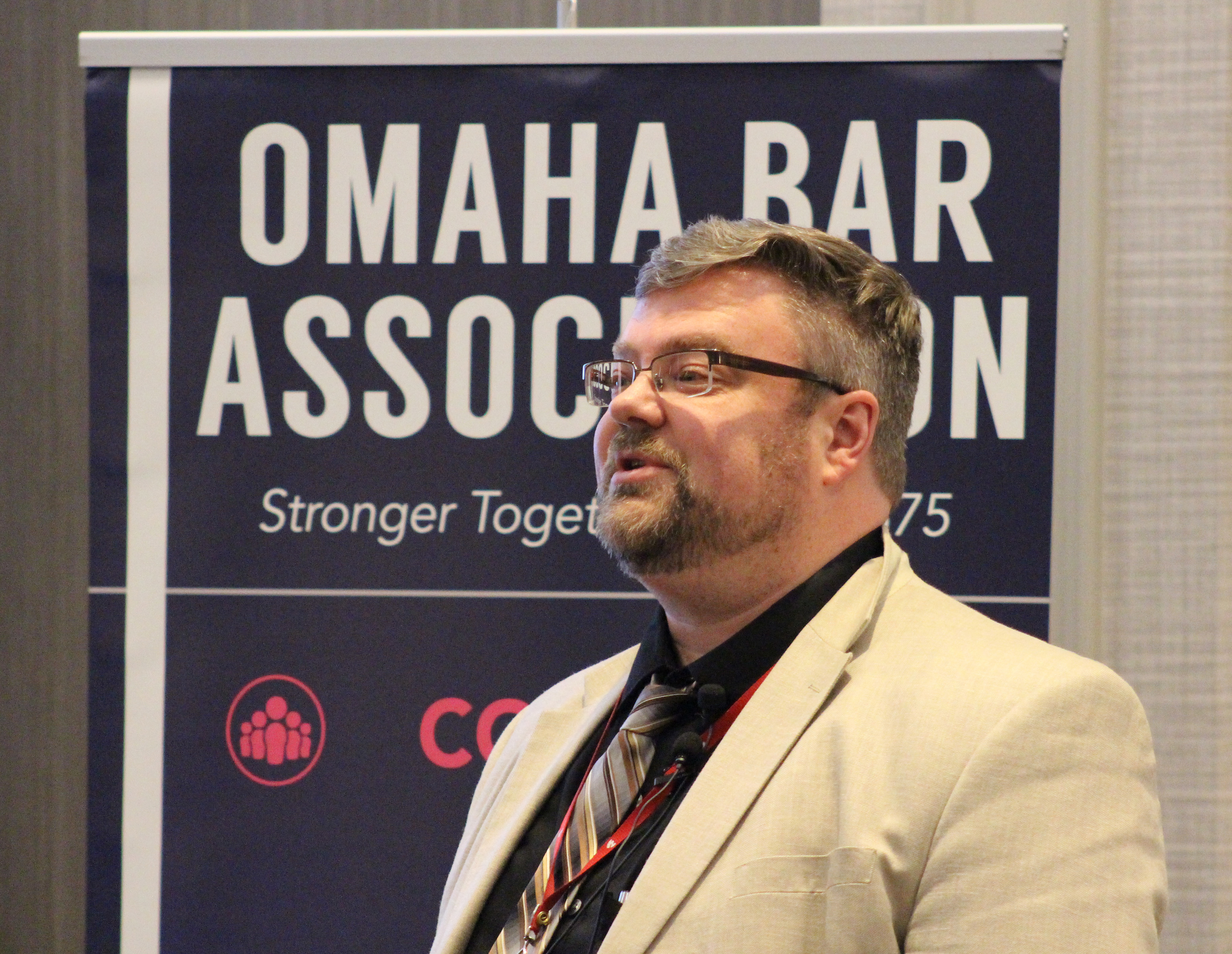 Matthew Garlinghouse, a professor of neuropsychology at the University of Nebraska Medical Center, addresses the crowd at the Medical Legal Dinner, a joint event held by the Omaha Bar Association and Metro Omaha Medical Society, on Thursday, March 5, 2020. (Photo by Scott Stewart)