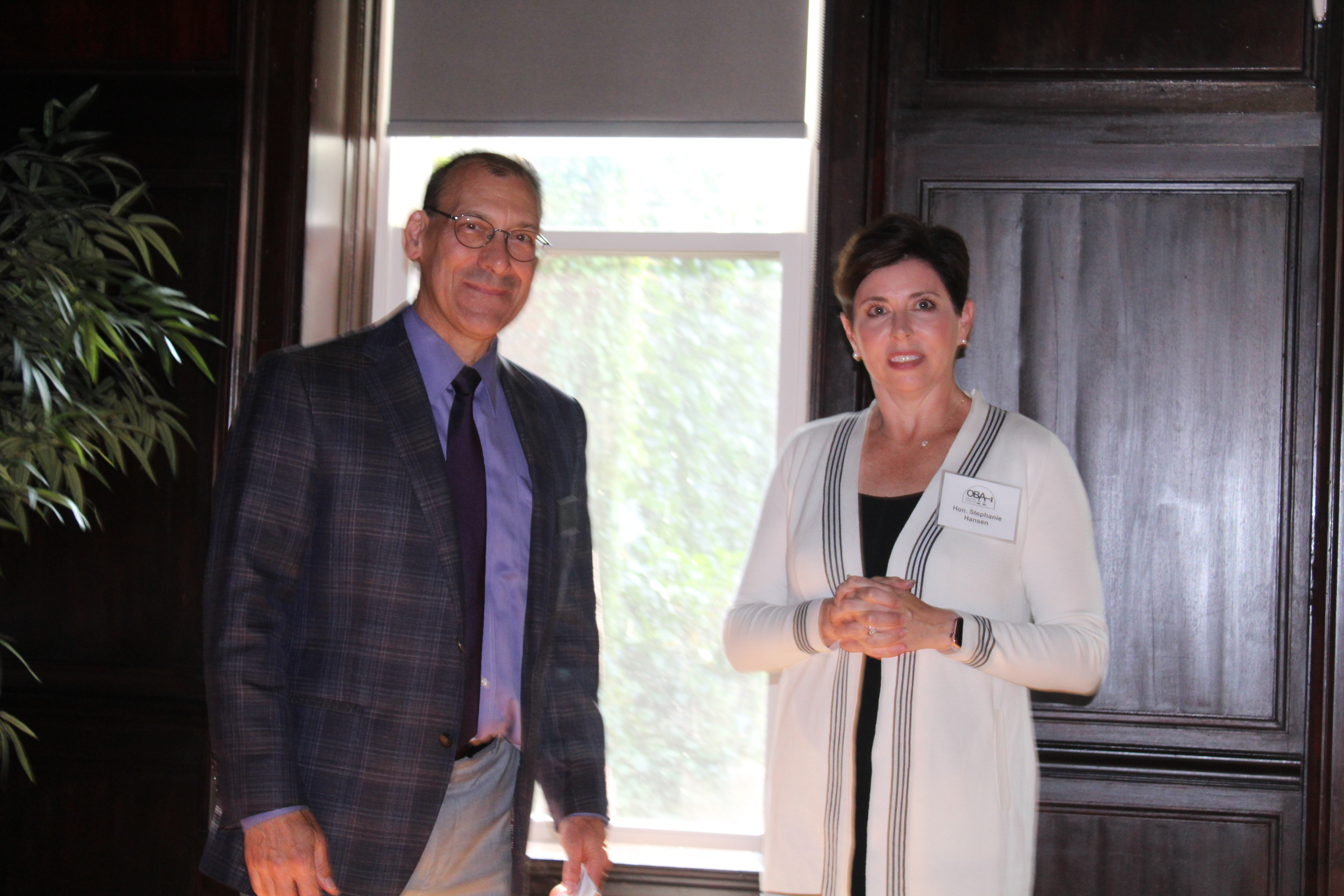 Outgoing OBA President Dave Koukol shares some words of wisdom with new president, Judge Stephanie Hansen, July 21, 2021. (David Golbitz/Daily Record)