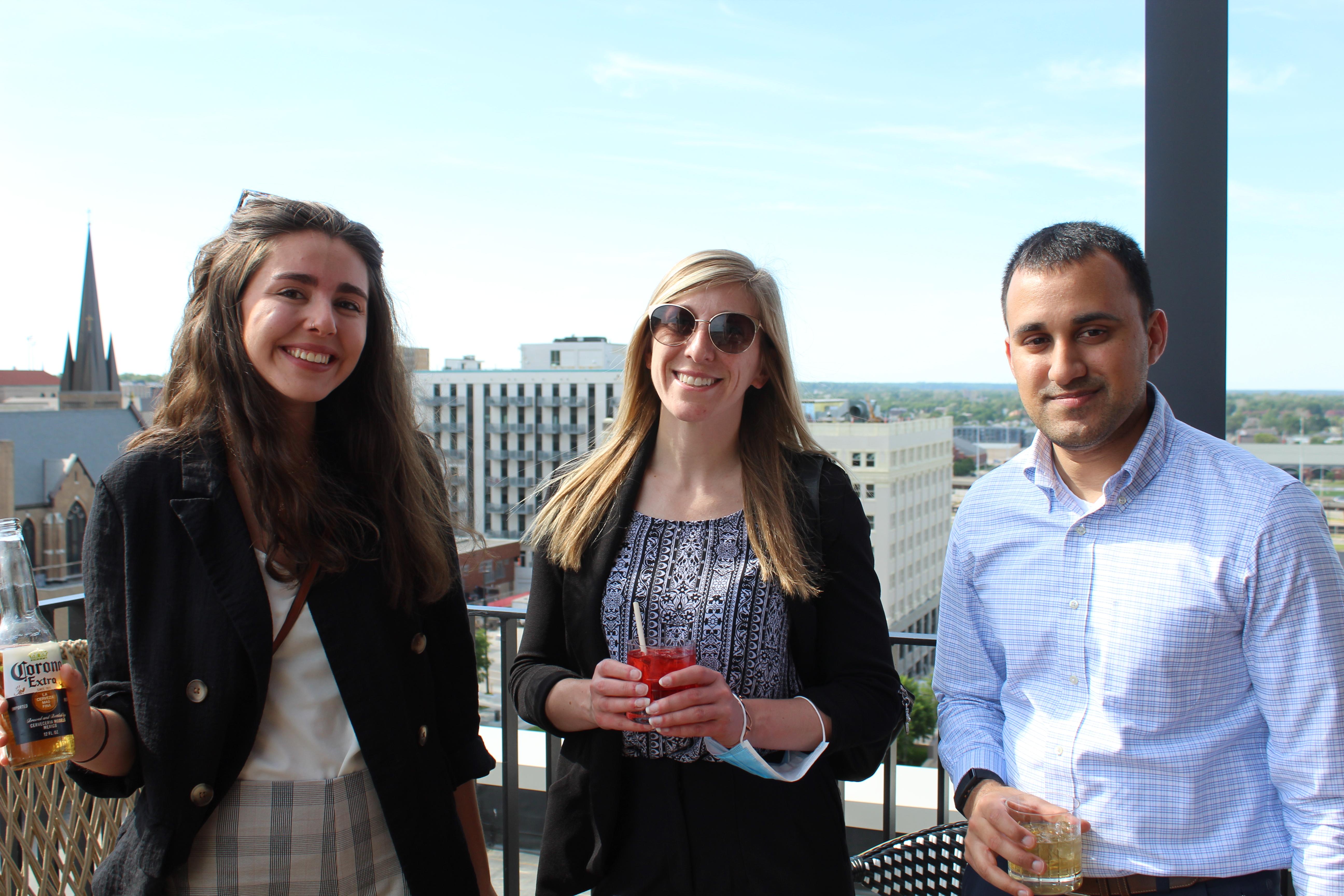 Modus Coworking Offices team members Emma Johnson, Laura Schoening and Rahul Agarwal enjoy a drink. (David Golbitz/Daily Record)