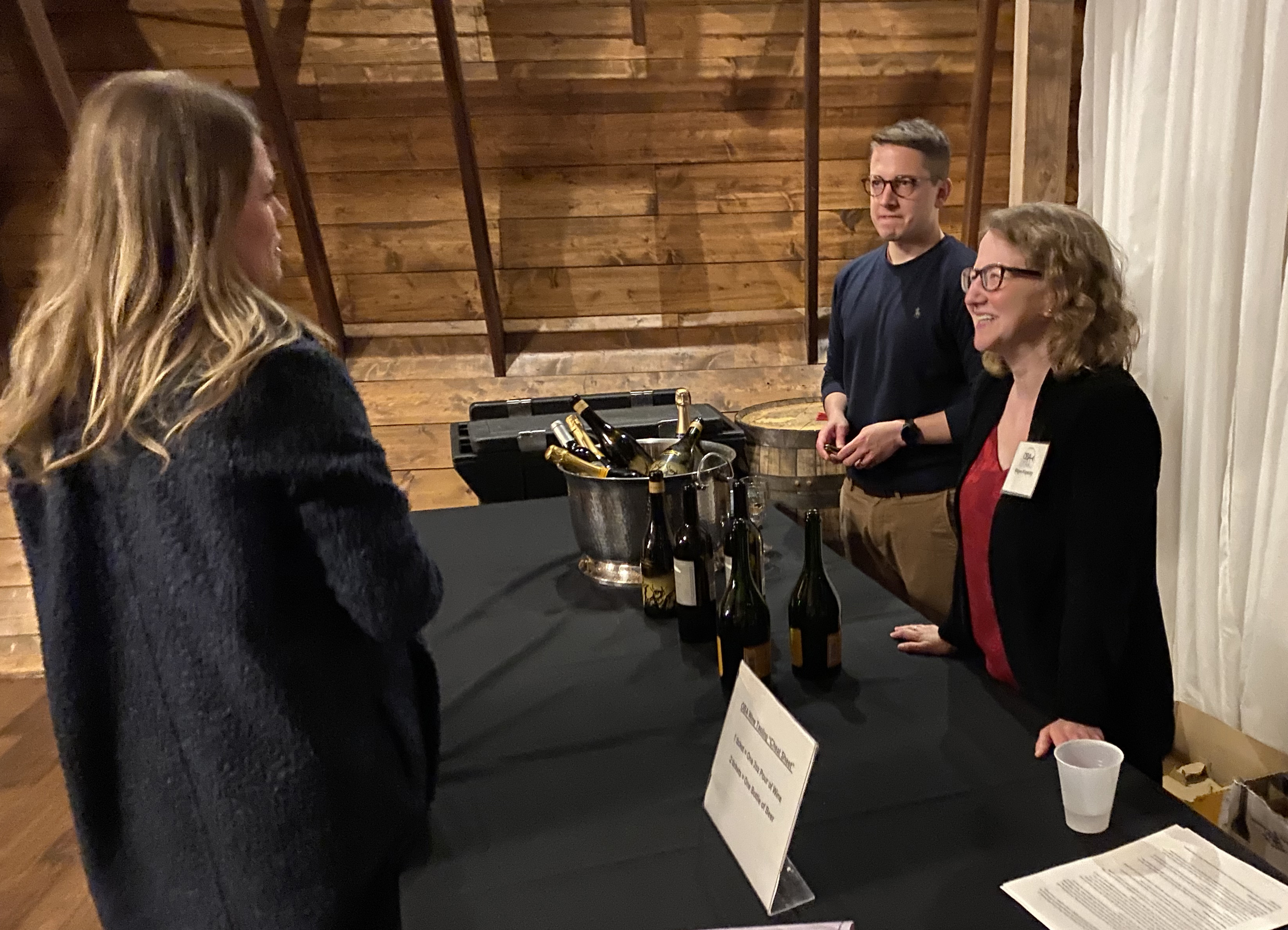 Volunteers from The Daily Record and Omaha Legal Professionals Association assisted the Omaha Bar Association with the preparations and operation of the 2020 wine tasting. (Scott Stewart/Daily Record)