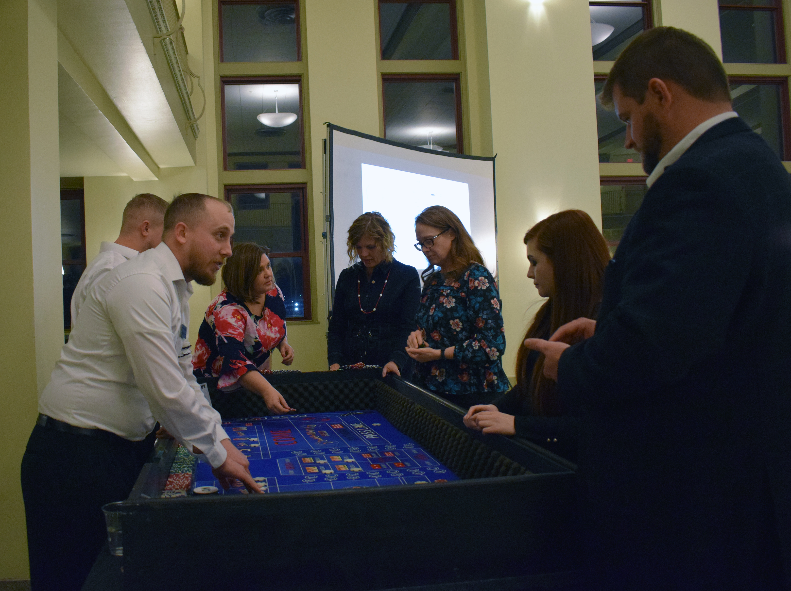 People enjoy a game of craps at the Casino Night at the Omaha Law League Casino Night at the Livestock Exchange Building on March 6, 2020. (Photo by Elizabeth A. Elliott)