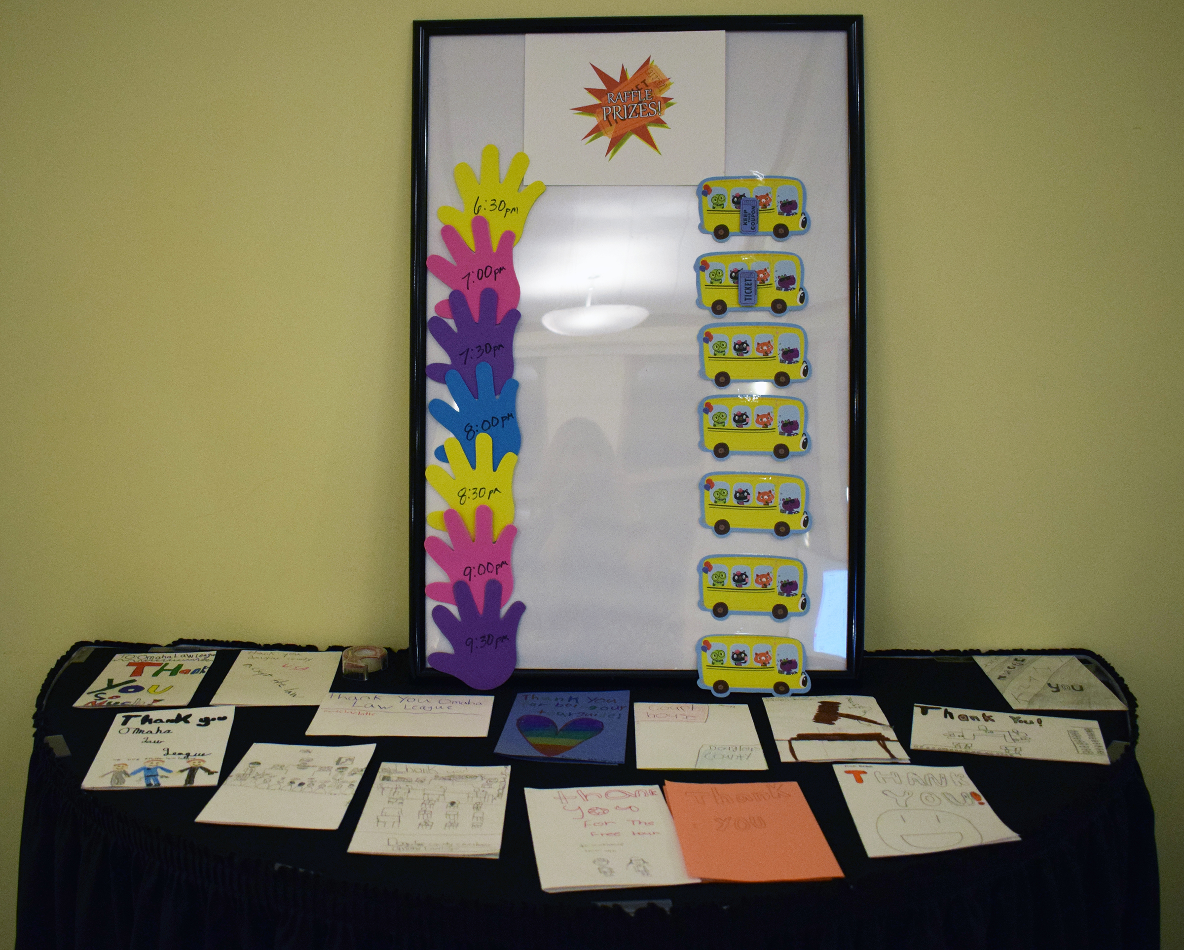 A table of thank you notes from students are on display at the Omaha Law League Casino Night at the Livestock Exchange Building on March 6, 2020. (Photo by Elizabeth A. Elliott)