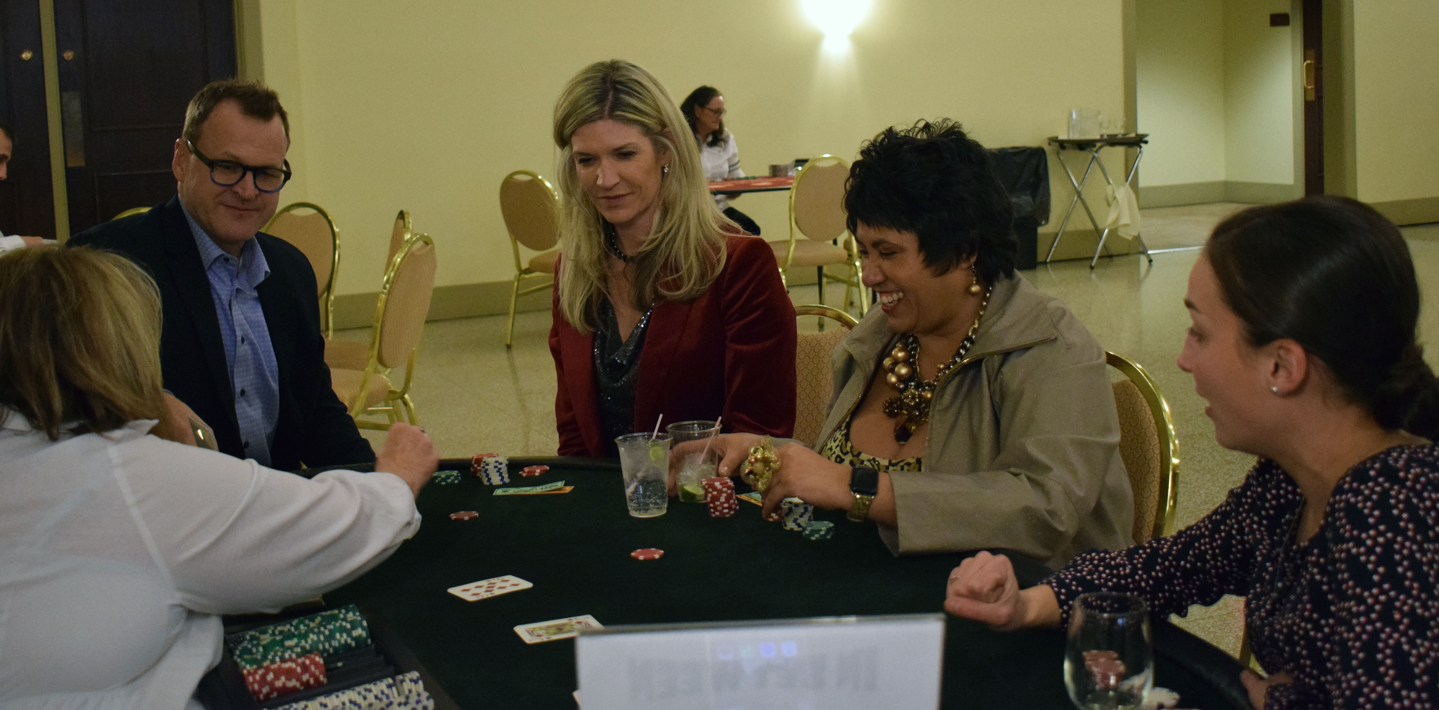 People learn how to play a casino game called In Between at the Omaha Law League Casino Night at the Livestock Exchange Building on March 6, 2020. (Photo by Elizabeth A. Elliott)
