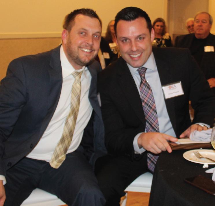 Aaron Wegner accepts the congratulations of law partner Michael Sands