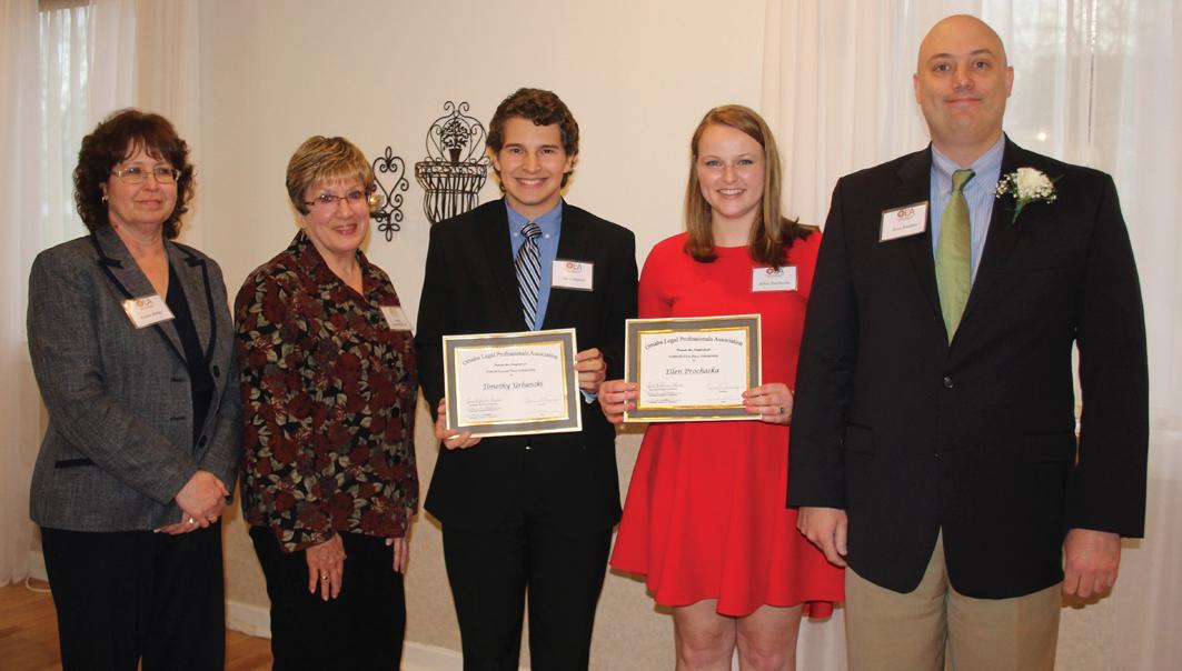 Scholarship winners Tim Urbanski and Ellen Prochaska (center) are announced by Donna Birkby, Lynda Jensen-Hansen and Dave Raddatz.