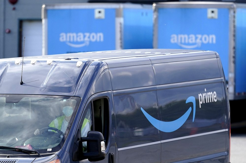 An Amazon Prime logo appears on the side of a delivery van as it departs an Amazon Warehouse location, Oct. 1, 2020, in Dedham, Mass. (AP)