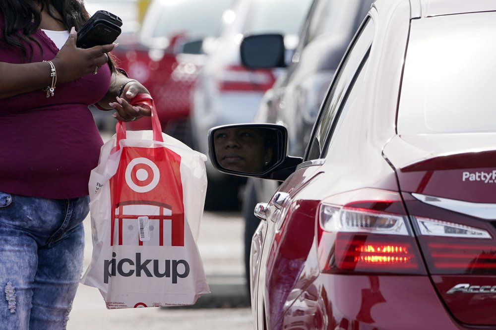 A Target employee prepares to delivery a curbside pickup purchase in Jackson, Miss., Nov. 5, 2020. (AP)