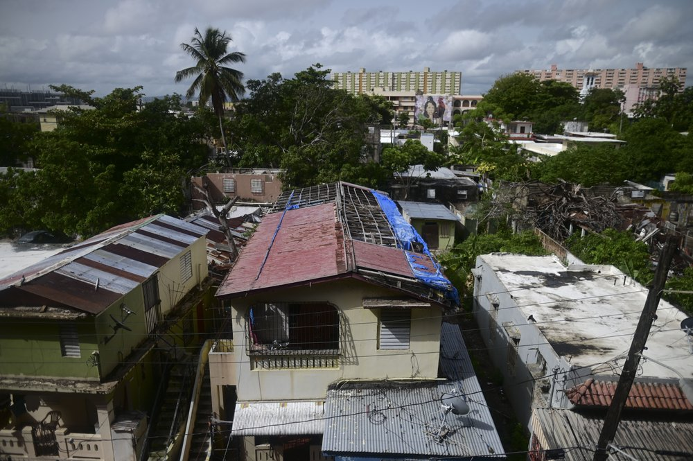 A hurricane-damaged home shows traces of a blue tarp installation in San Juan, Puerto Rico, Monday, July 13, 2020, nearly three years after Hurricane Maria tore through the island. The federally funded program R3 named for its efforts to repair, rebuild or relocate, which began in July 2019, hasn't yet finished a single home. (AP)