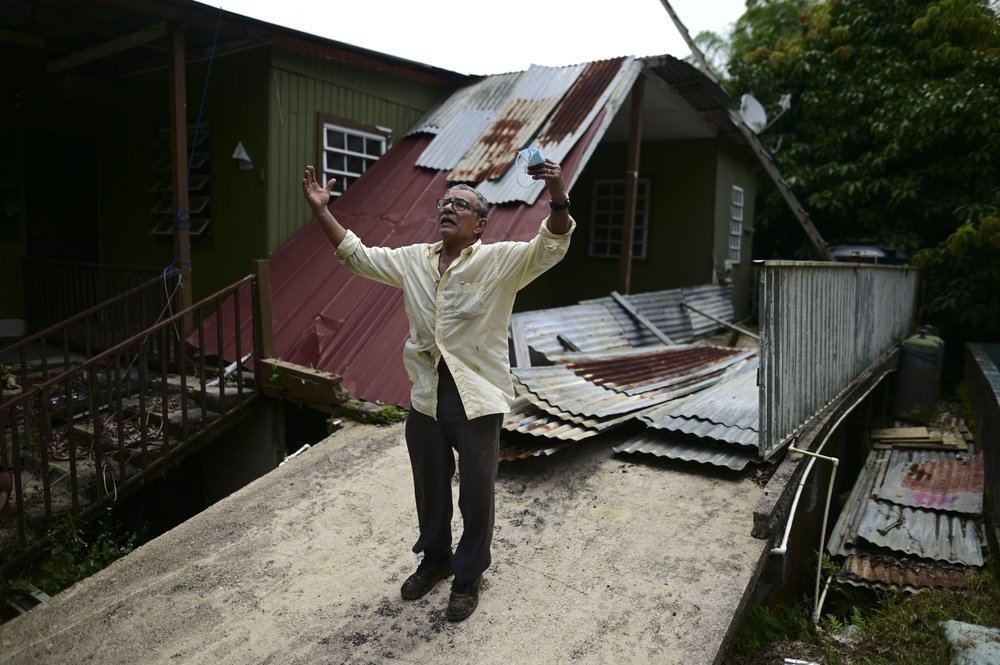 Manuel Morales Ortíz explains what his home suffered during the 2017 hurricane season, in Corozal, Puerto Rico, Monday, July 13, 2020. Nearly three years after Hurricane Maria, tens of thousands of homes remain badly damaged. (AP)