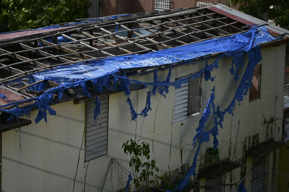 Nearly three years later, a hurricane-damaged home shows traces of a blue tarp installation in San Juan, Puerto Rico, Monday, July 13, 2020. Maria slammed into Puerto Rico on Sept. 20, 2017, obliterating the electricity grid, demolishing or damaging nearly 357,500 homes, and causing more than an estimated $100 billion in damage. (AP)