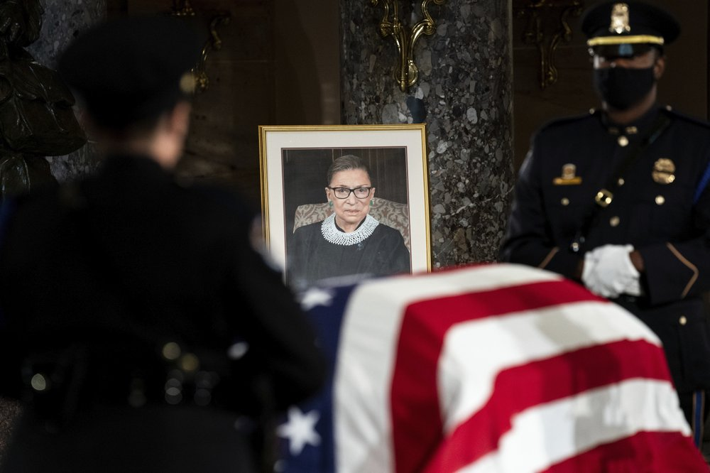 The flag-draped casket of Justice Ruth Bader Ginsburg lies in state in the U.S. Capitol on Friday, Sept. 25, 2020. Ginsburg died at the age of 87 on Sept. 18 and is the first women to lie in state at the Capitol. (Erin Schaff/ New York Times via AP)