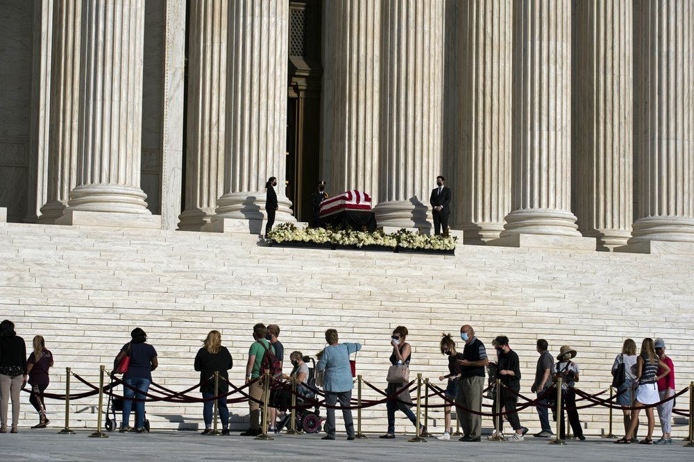 Mourners pay their respects as Justice Ruth Bader Ginsburg lies in repose under the Portico at the top of the front steps of the U.S. Supreme Court building on Wednesday, Sept. 23, 2020, in Washington. Ginsburg, 87, died of cancer on Sept. 18. (AP)