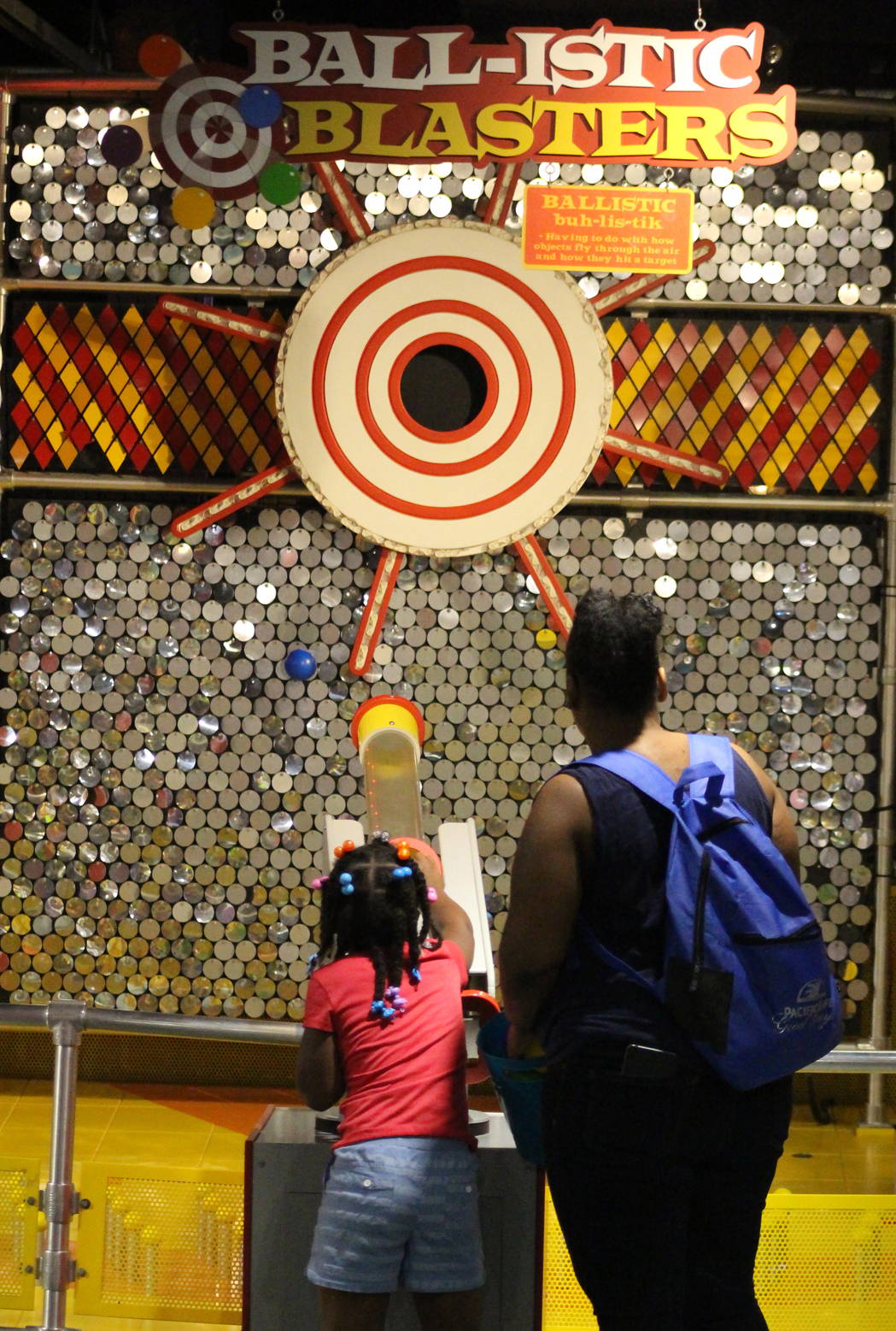 A child shoots a ball on the Ball-istic Blasters game at the Omaha Children's Museum during the 10th annual Summer Family Reunification Picnic on June 7, 2019. (Photo by Scott Stewart)
