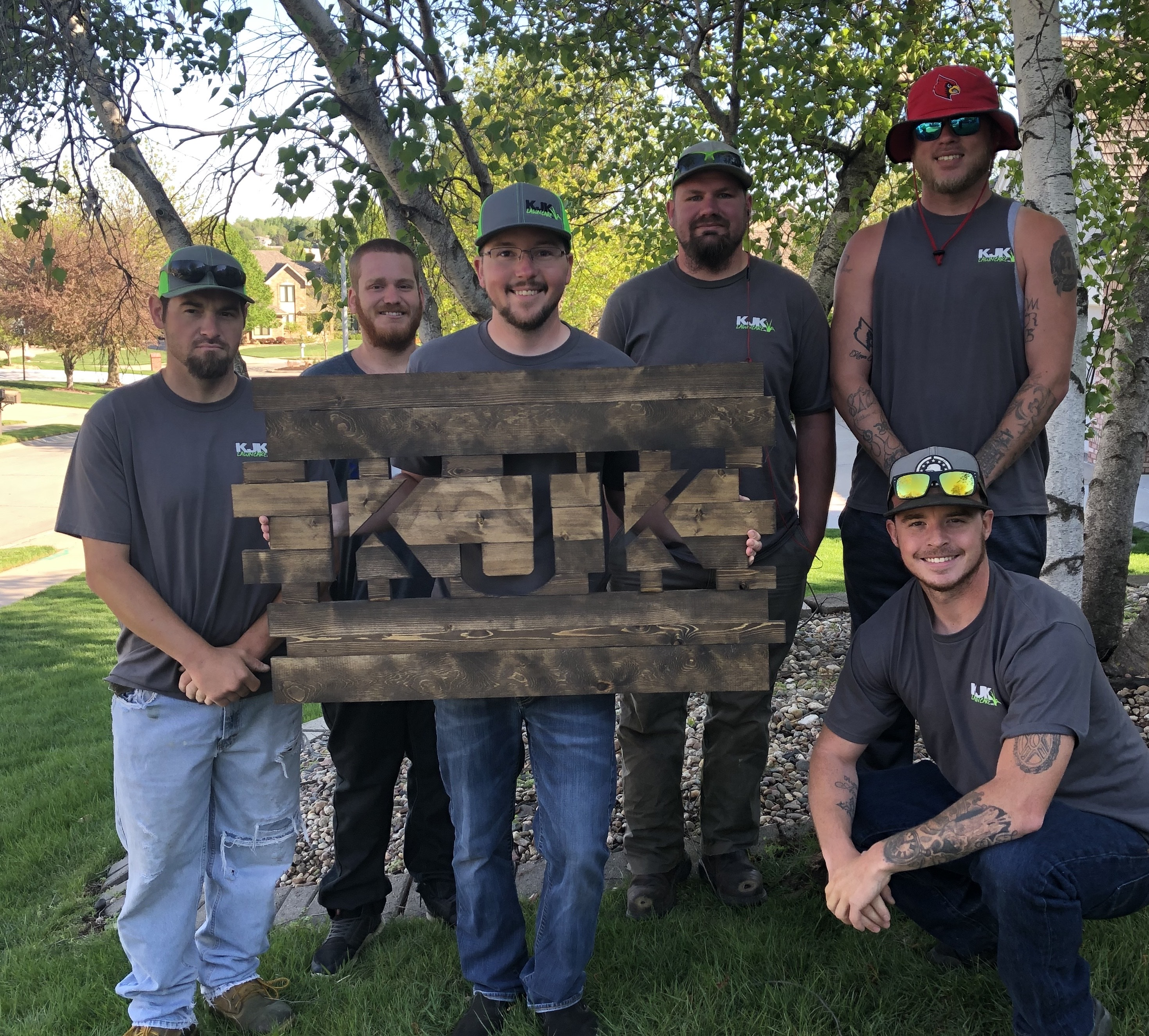 The team at KJK Lawncare pose for a portrait. The company is this month's Greater Omaha Chamber Small Business of the Month. (Courtesy KJK Lawncare)