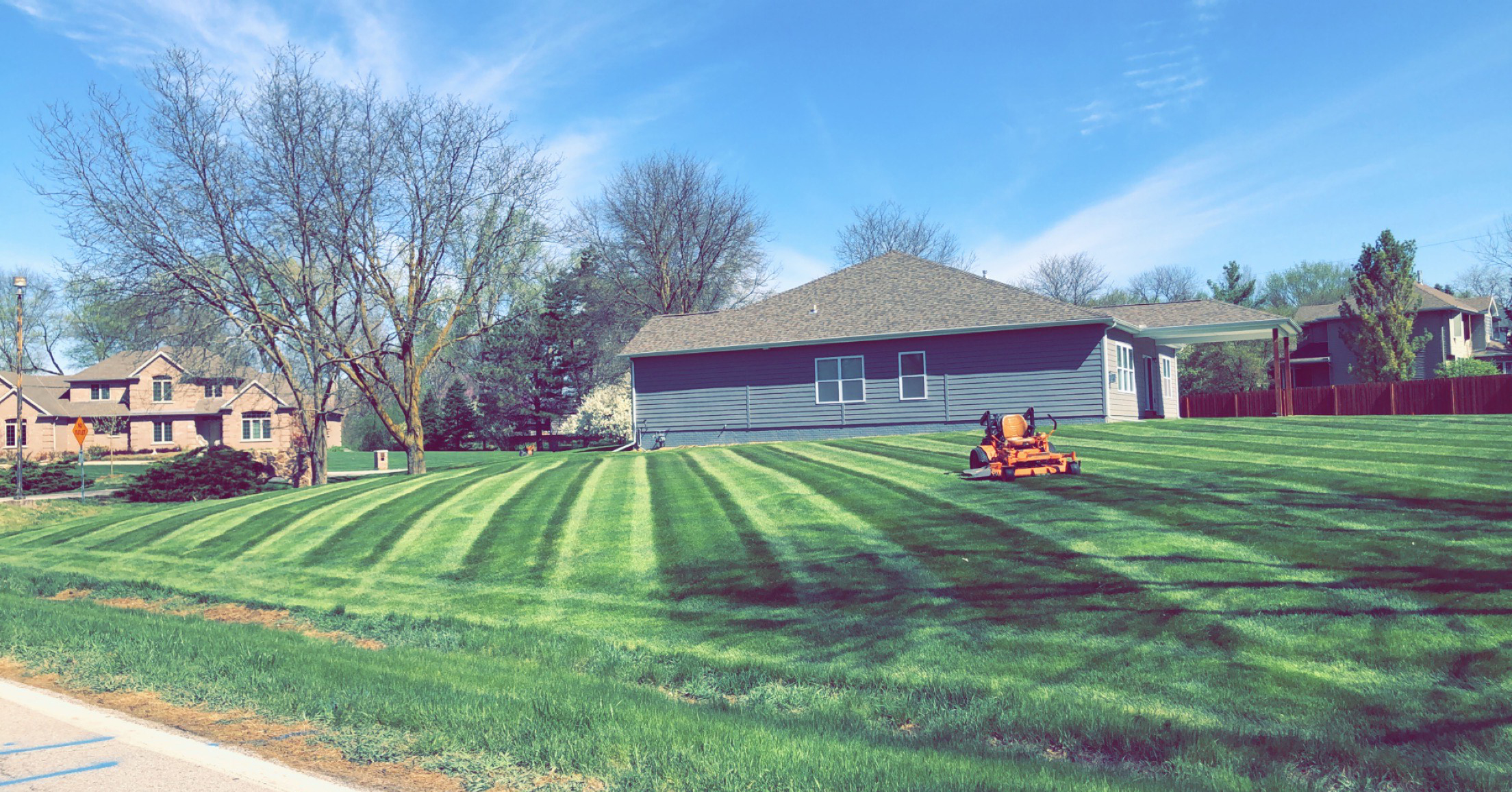 KJK Lawncare is known for mowing stripes, such as the lawn shown in this photo. (Courtesy KJK Lawncare)