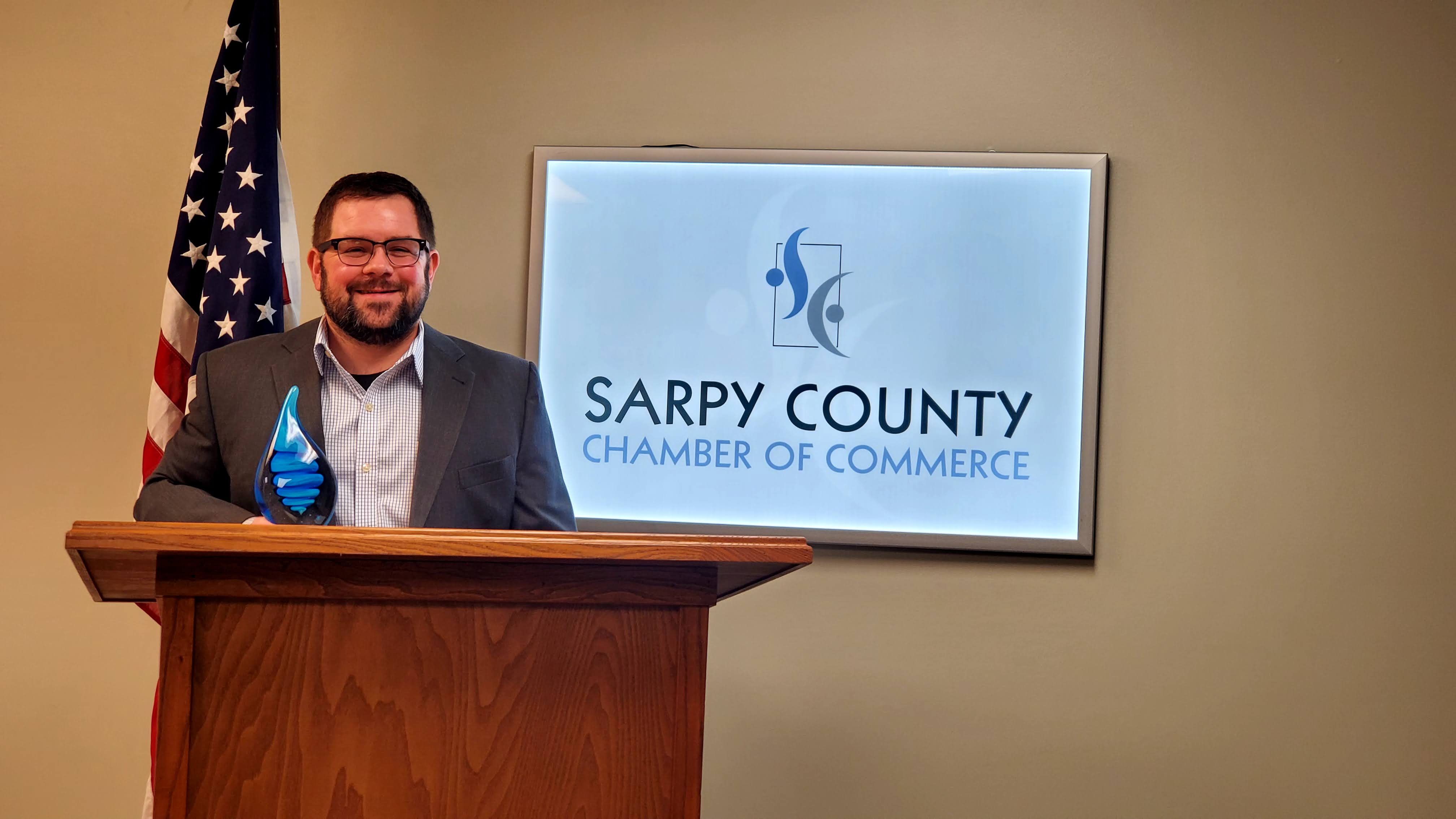 Ryan Ousey of ROC Business Technologies accepts the chamber's New or Emerging Business of the Year Award. (Sarpy County Chamber)