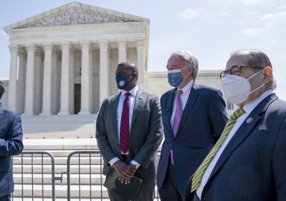 From left, Rep. Mondaire Jones, Sen. Ed Markey and Rep. Jerrold Nadler  hold a news conference outside the Supreme Court, Thursday, April 15, 2021. (AP)